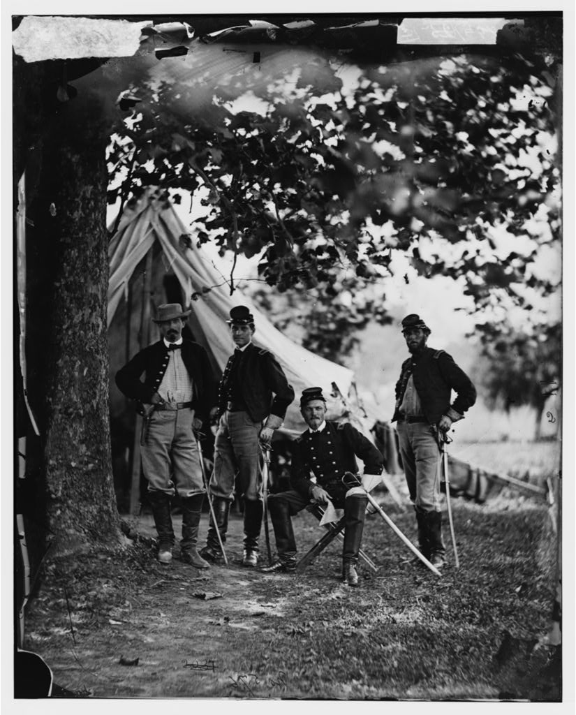 William Woods averell, seated, would accept Fitz Lee's Challenge to pay him a visit, resulting in the battle at Kelly's Ford.