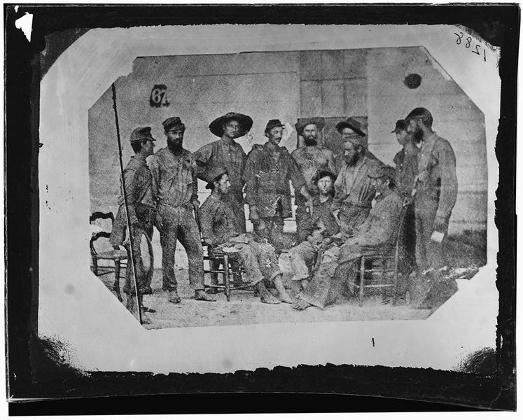 Soldiers of the 19th iowa Infantry pose for a photograph in New orleans after being Exchanged out of Camp Ford