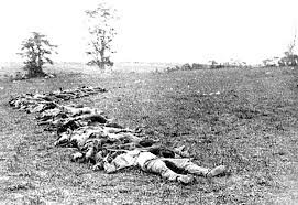 Crews separated Union and Confederate soldiers into lines for trench burial on the field.