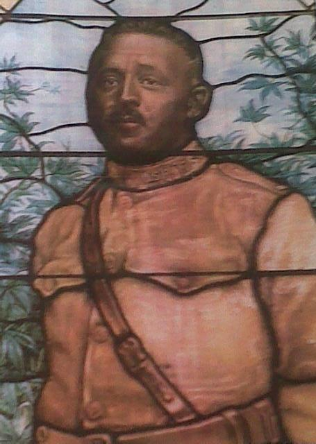 Stained glass window depicting Urbane Bass.