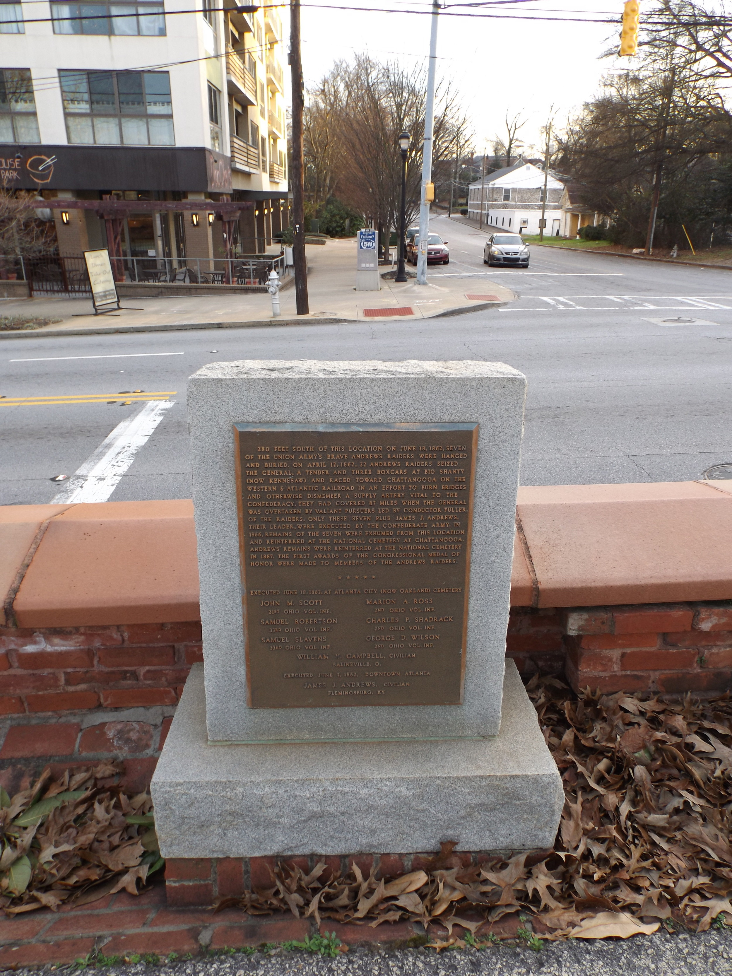 Marker in Oakland Cemetery (previously the Atlanta Graveyard) noting the execution of the seven Raiders.