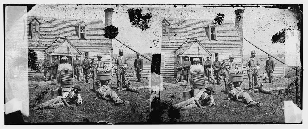 "A group of ""contrabands"" at Yorktown. Library of Congress."