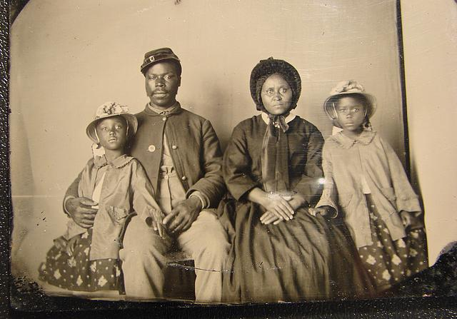 An Unidentified Union USCT Soldier Poses with his family for a photograph
