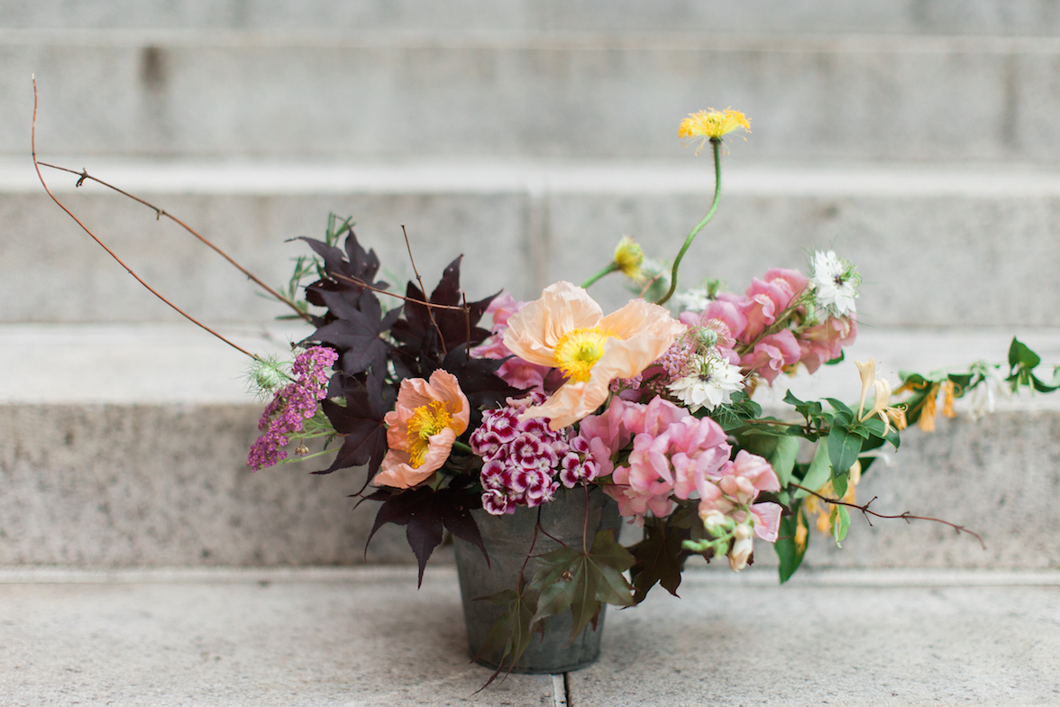 Demo piece composed of yarrow, poppies, dianthus, snapdragons, love-in-a-mist, honeysuckle, and japanese maple