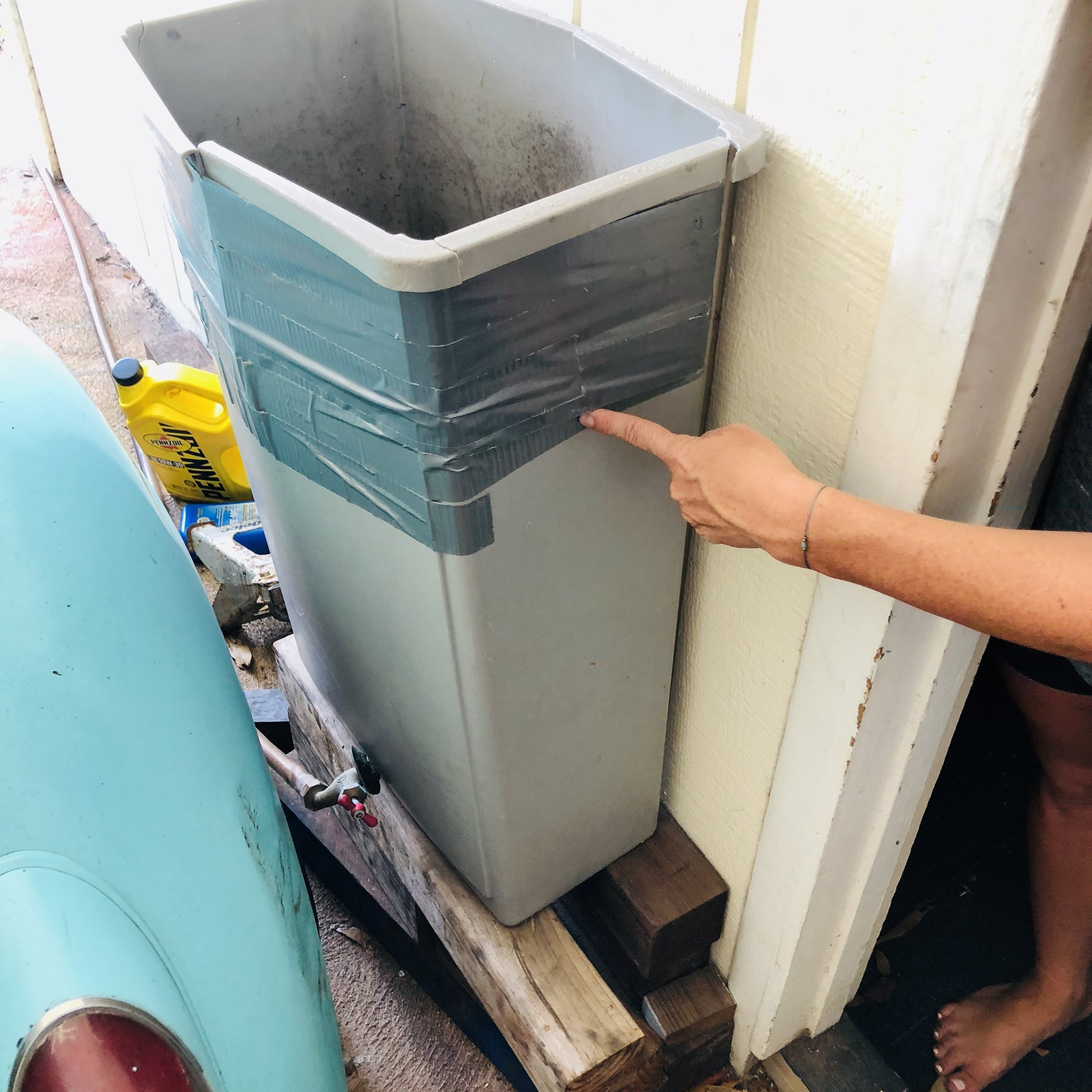 Converted trash can to hold grey water.