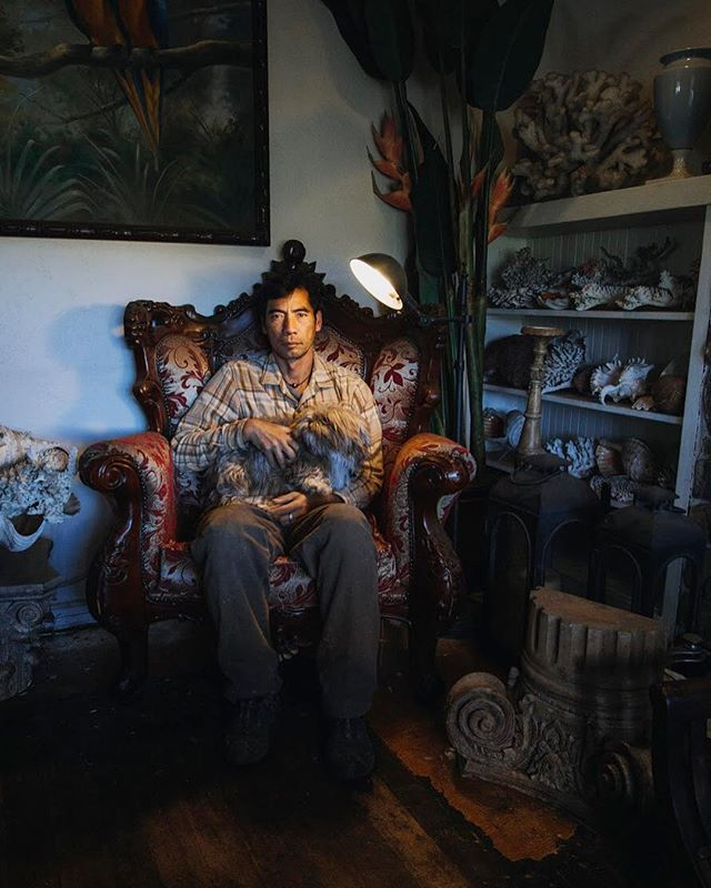 Environmental portrait of Farmer George. In this photo he's holding 1 of 13 unique shih tzu's that protect his farm, which is located in the suburbs of San Diego. To his left, is a collection of rare coral and shells he gathered from Hawaii where he was born and raised. This is just a fragment of what I learned about George that day. I should finish this series and just make a photo book on this man. . #enviromentalportrait #portraitphotography #natgeoyourshot