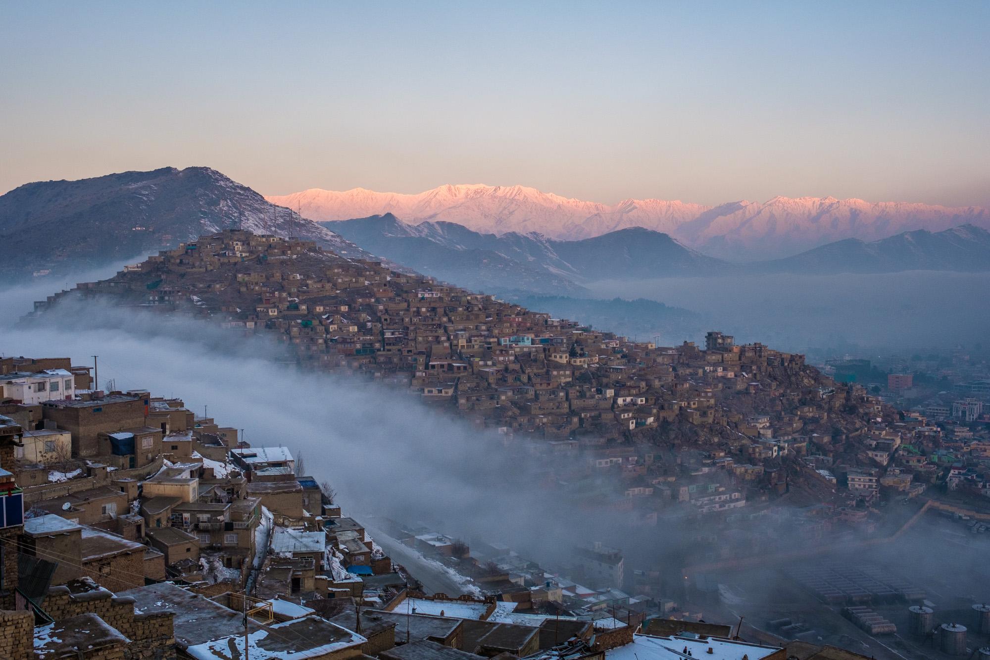 Morning fog rolls over the shoulder of TV hill, in central Kabul. 2018.
