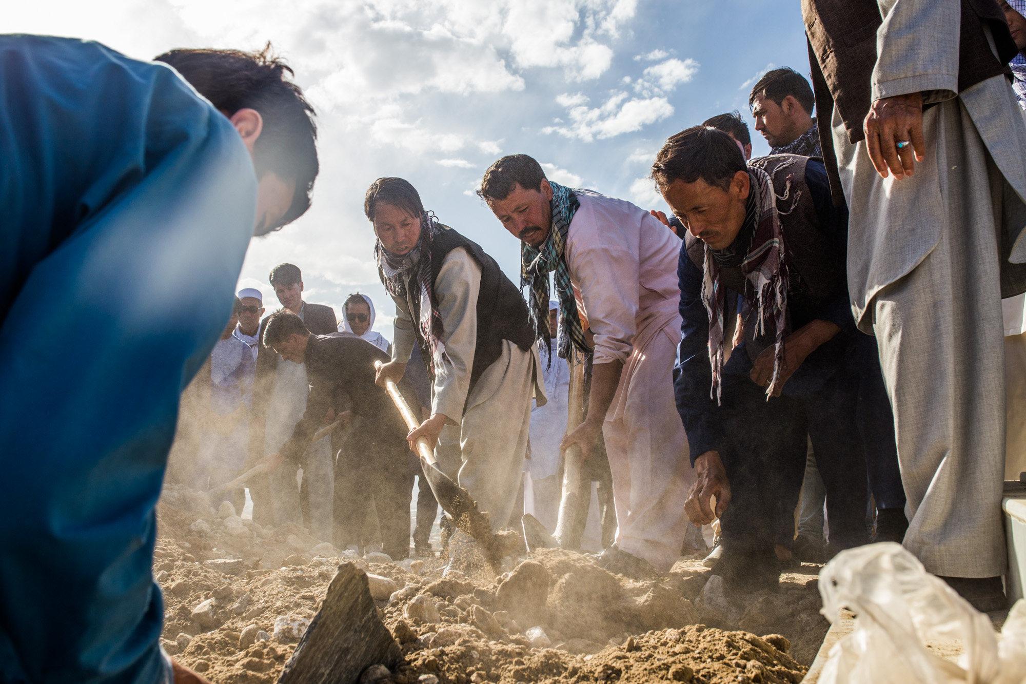 Friends and family bury the body of Rahmatullah Nasiry, a young teacher and journalist killed in the massive May 31st truck bombing in Kabul's green zone. Kabul, 2017.