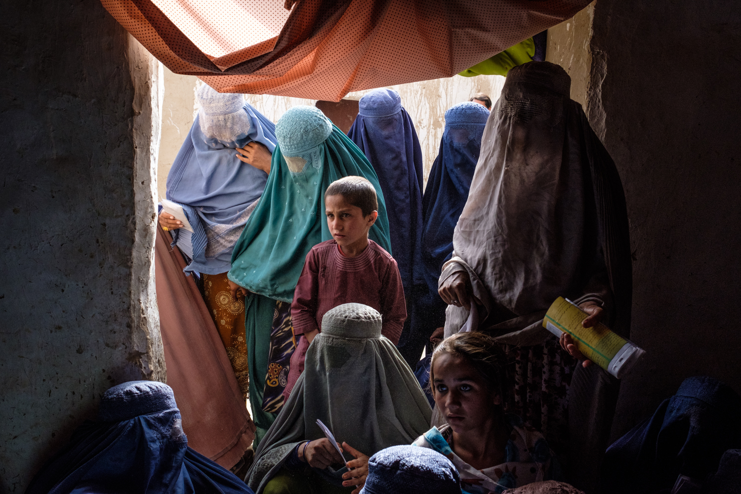 Afghan women, all IDPs, recently forced to leave their adopted homes in Pakistan. Kandahar City, 2018.