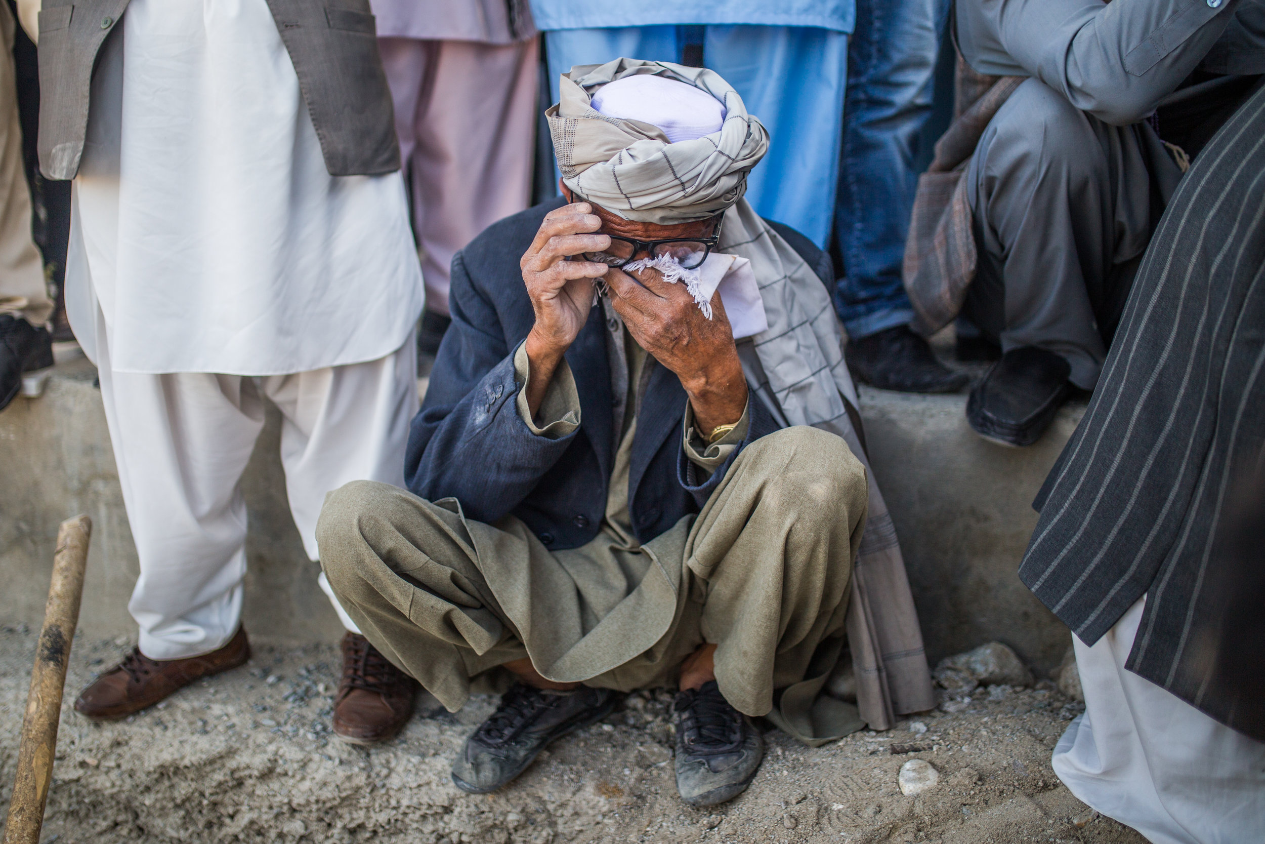 A relative grieves at the funeral of Rahmatullah Nasiry, a young teacher and journalist killed in the massive May 31st truck bombing in Kabul's green zone. Kabul, 2017.