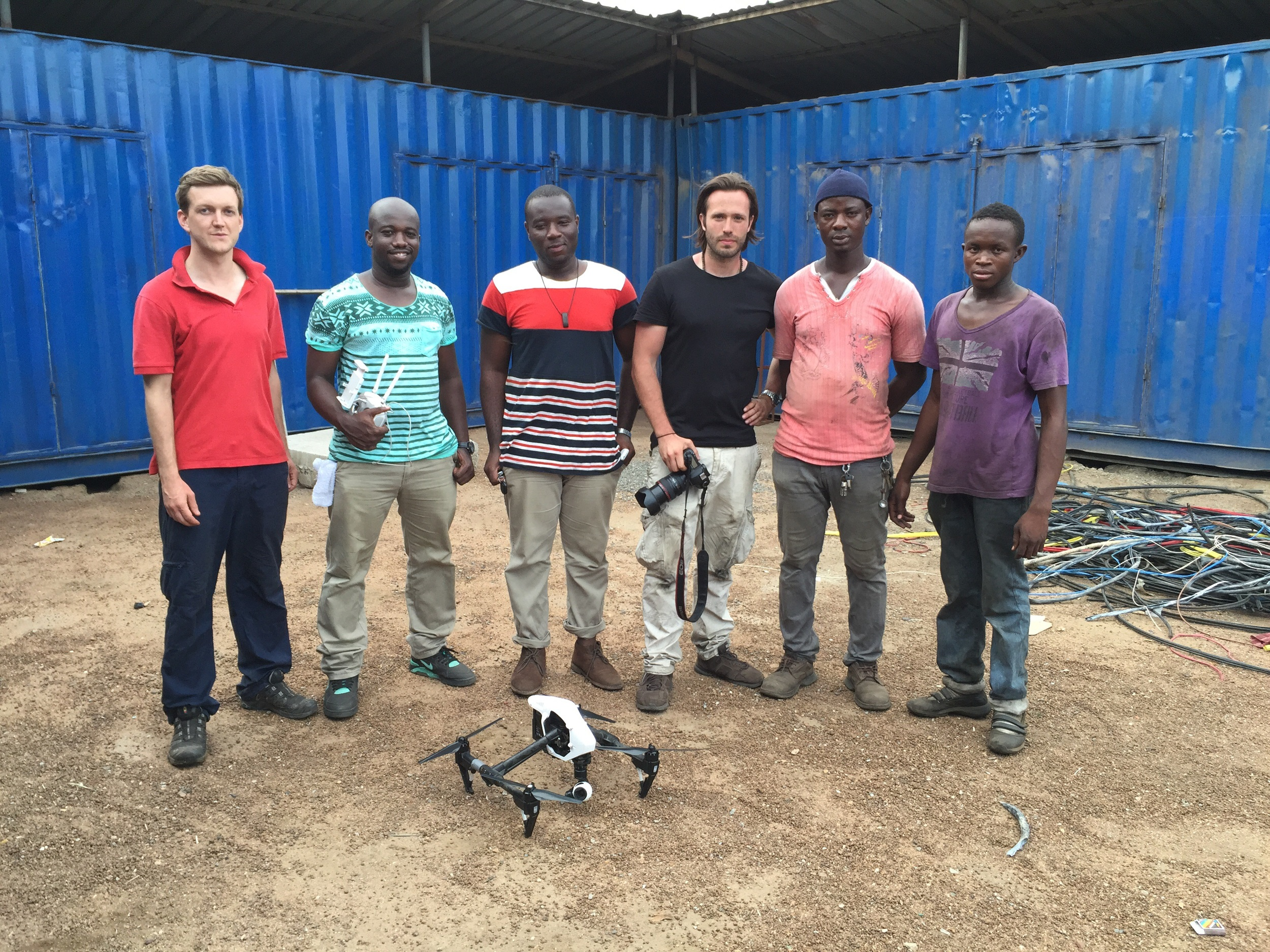 Drone filming at Agbogbloshie with (from left) Huw P-W, Hasel from Aeroshutter, our Ghana Production Manager Justice Anthony, Alexis Wilski, our Agbogbloshie guide Karim, and our actor for the day Abdullah (Carlos).