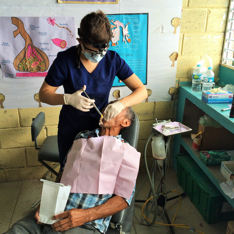Dr. Berry  providing care.
