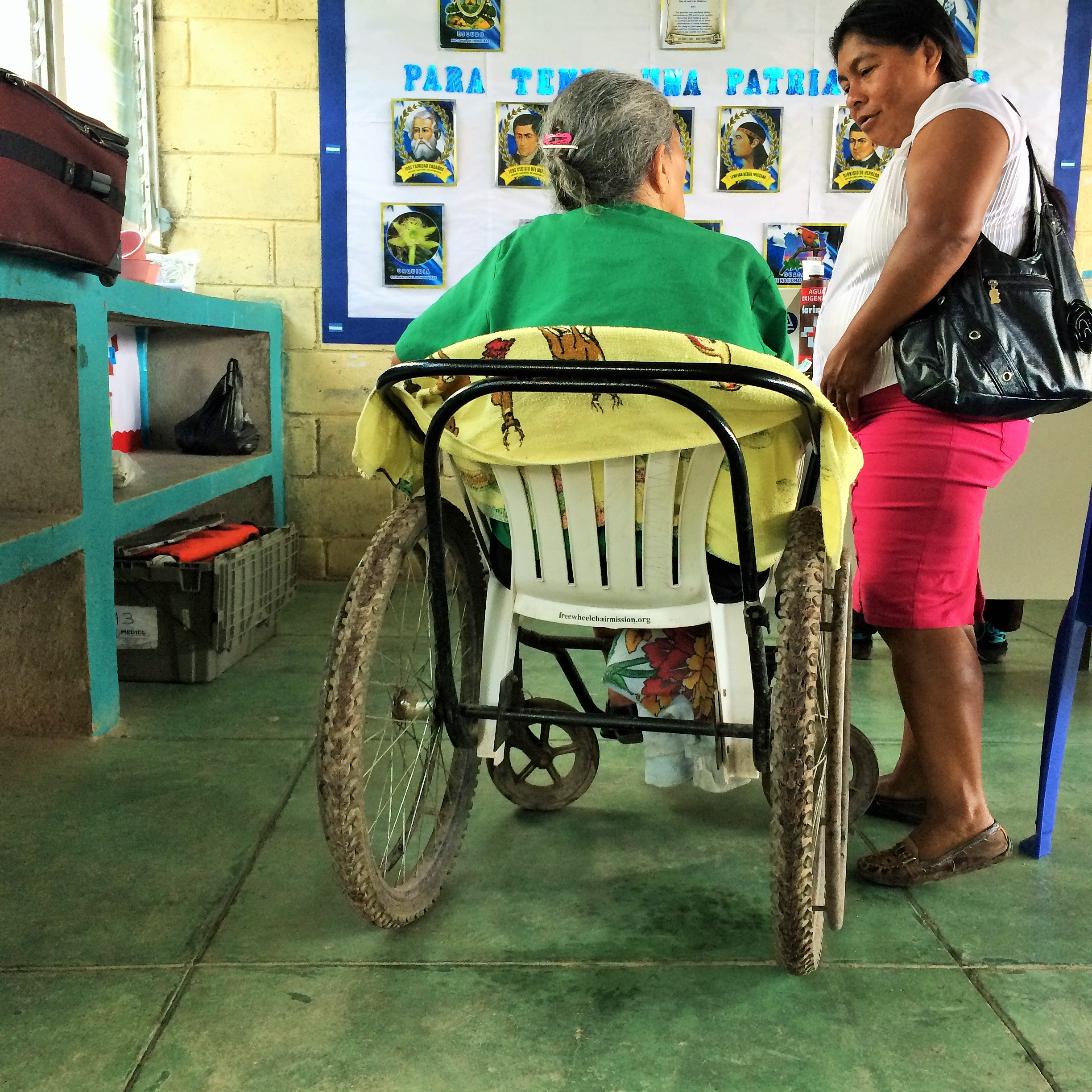 An innovative wheelchair fabricated out of a lawn chair and bike tires enabled this woman to make it to the clinic for care.