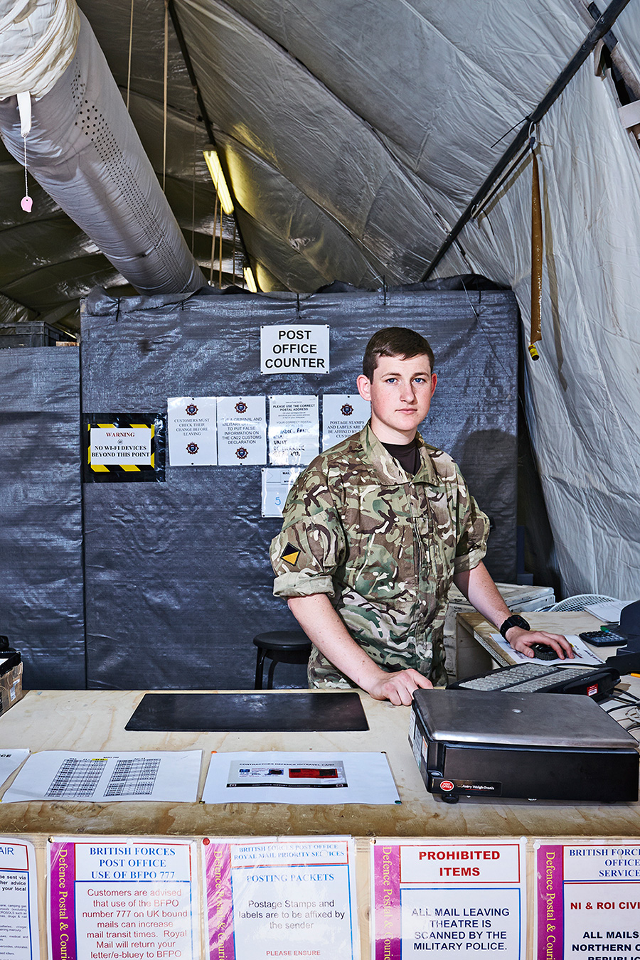 6 SHEET POSTER IN MUSWELL HILL, LONDON   Photographed in early May 2014 and situated in a large tunnel shaped tent, this is the Post Office counter in Camp Bastion.