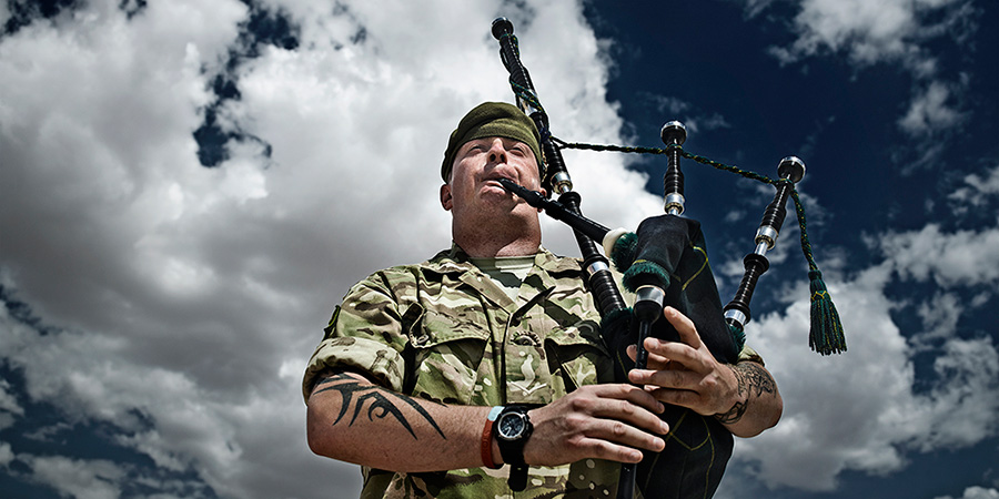 48 SHEET POSTER IN GALASHIELS, ETTRICK AND LAUDERDALE   The piper here was shot in Camp Bastion just before his battalion was due out beyond the wire (perimeter fence).  He would traditionally play the pipes in front the vehicles whilst leading them out.