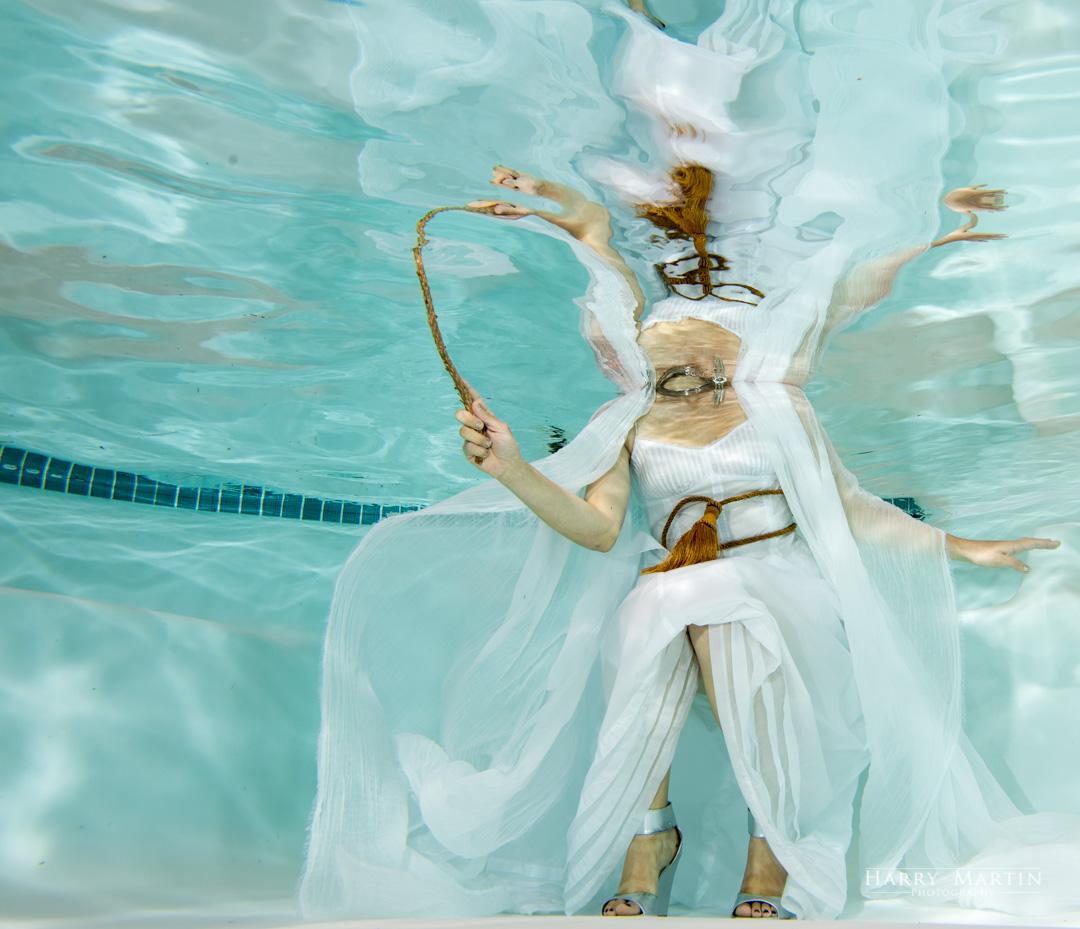 Casting an underwater spell.