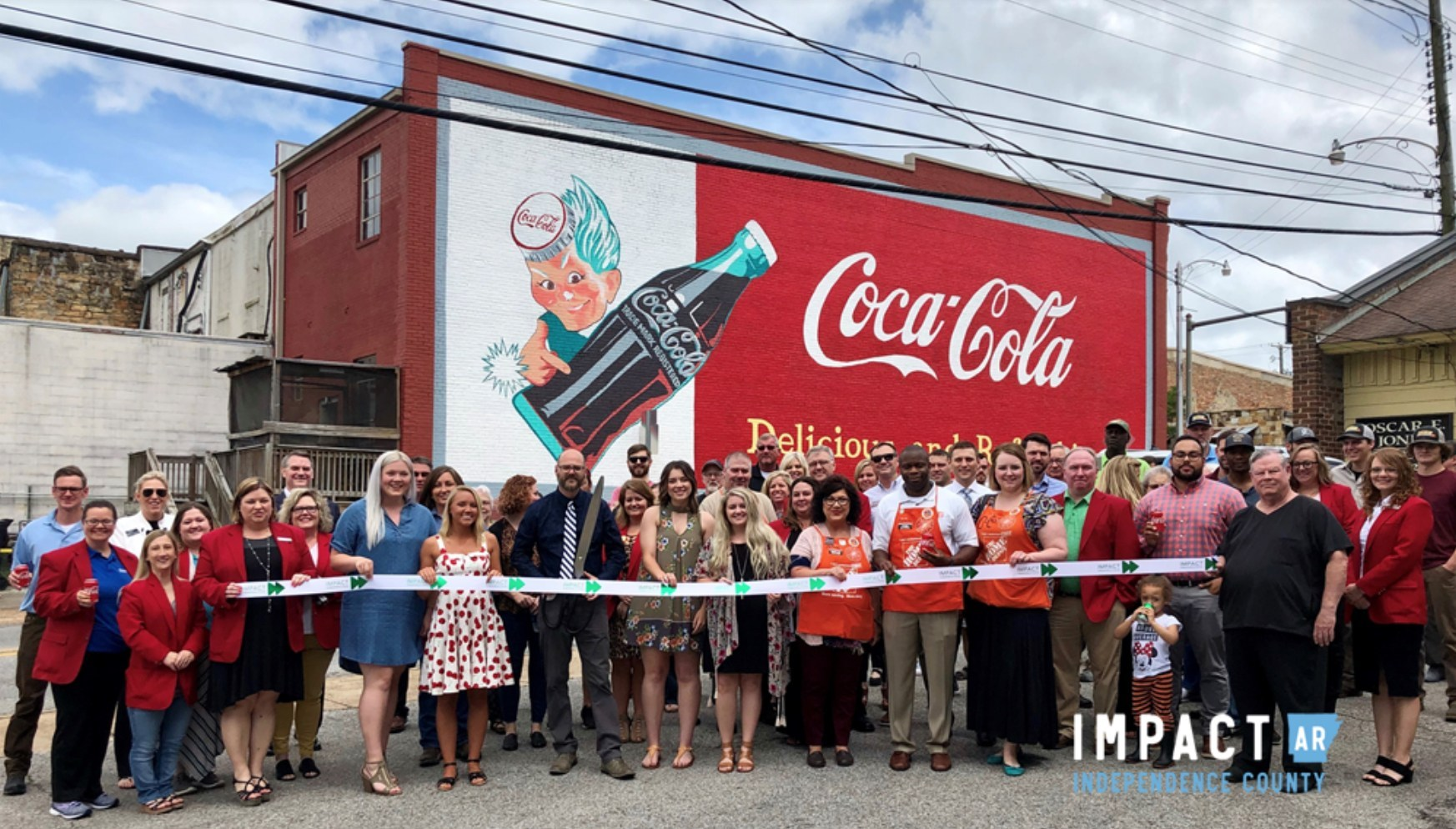Coca-Cola-mural-ribbon-cutting.jpg