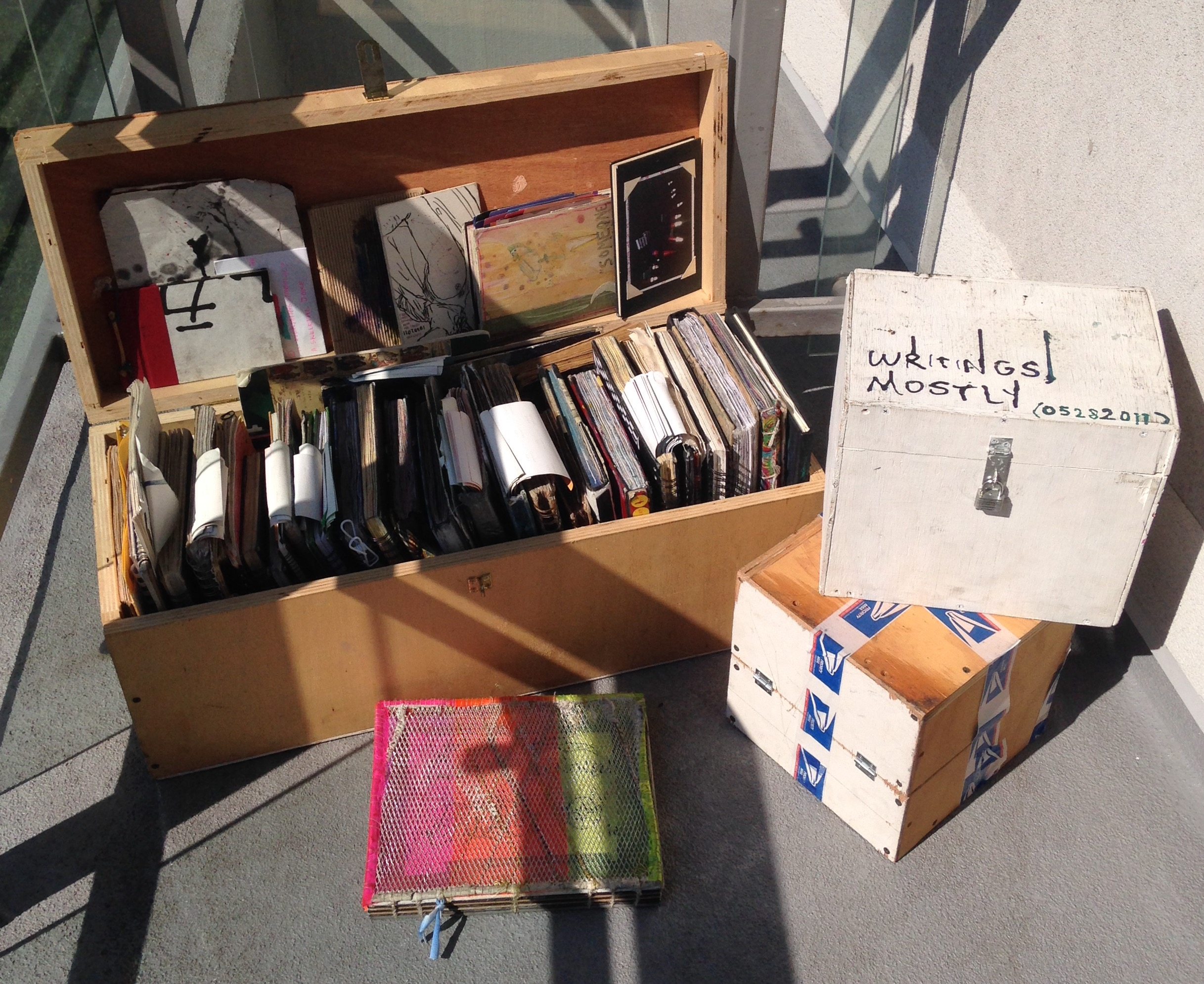 Sketchbooks and Journals in handmade boxes, on a balcony in NYC (2016)