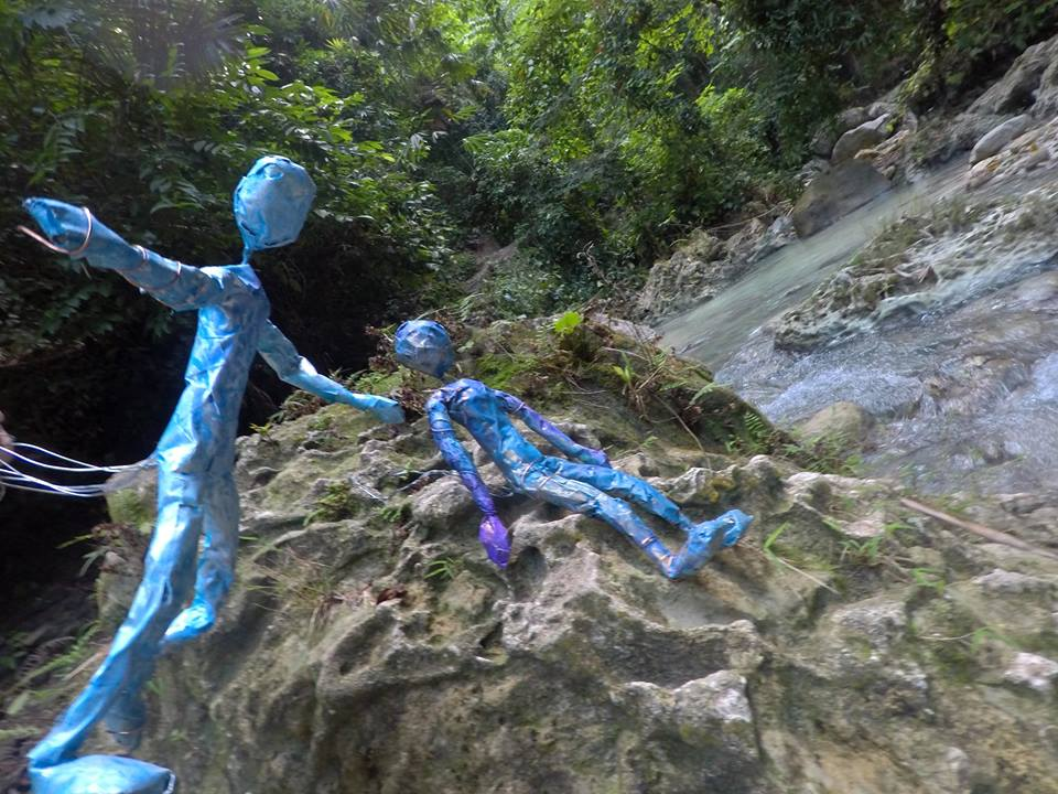 Lihangin (god of Wind) and Lidagat (god of Sea), celebrating at Dao Waterfalls