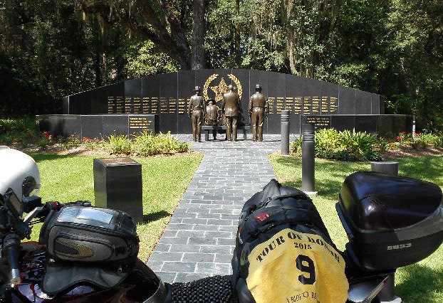 FL1 - Florida Sheriffs Memorial Wall  Tallahassee, Florida 2617 Mahan Dr. GPS: 30.456875, -84.233899 Access: 24/7, unrestricted. Parking is available in several adjoining areas, while lining up directly in front of the memorial might be considered 'high profile.'  Take a photo similar to the one above, along with rider flag and motorcycle. Refer to RULES 5-7 ( http://www.tourofhonor.com/pages/rules.html#rules57 ) for photo verification. Scorers have final say whether standards are met. More....  The Florida Sheriffs Association established this memorial wall in 2002 to honor the heroes of Sheriffs' Offices killed in the line of duty. Names are added each April for those who died in the previous year. Tallahassee resident and sculptor Sandy Proctor created a sculpture featuring a bench with a group depicting the wife of a fallen deputy, her small child, a sheriff and fellow deputies facing the curved marble wall engraved with the names of the fallen officers.