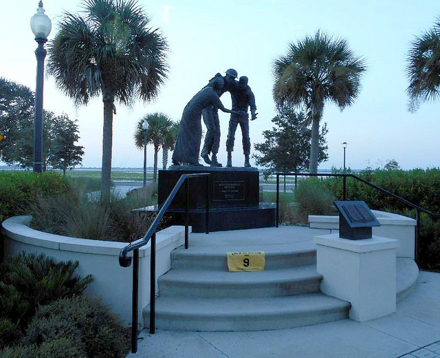 FL4 - Bataan-Corregidor Memorial  Kissimmee, Florida  Lakefront Park Lakeshore Dr. and Monument Ave. GPS: 28.29047, -81.40307 Access: 24/7, unrestricted Parking is available on the street within picture distance of the statue – but if there is no space available, you can park temporarily at the pedestrian crossover for a photo of the back of the memorial, and then walk in for another photo from the front if you like. The walkways to the memorial are ADA compliant.  Take a photo similar to the one above, along with rider flag and motorcycle. Refer to RULES 5-7 ( http://www.tourofhonor.com/pages/rules.html#rules57 ) for photo verification. Scorers have final say whether standards are met. More.... A poignant memory of the siege of Bataan and Corregidor.  Gen. Douglas McArthur and his forces had retreated to the Philippine island of Corregidor and the Bataan Peninsula. From there, American and Filipino forces battled the Japanese for 99 days without resupply until finally the entire 76,000 man Bataan contingent was forced to surrender. The next day began the infamous Bataan Death March, a grueling 65 miles with no food, water, or rest. Reportedly, 10,300 died during the march and 31,000 died of disease or were executed within 90 days, after reaching prison camps in Luzon. (Orlando Sentinel Article April 8, 1994)