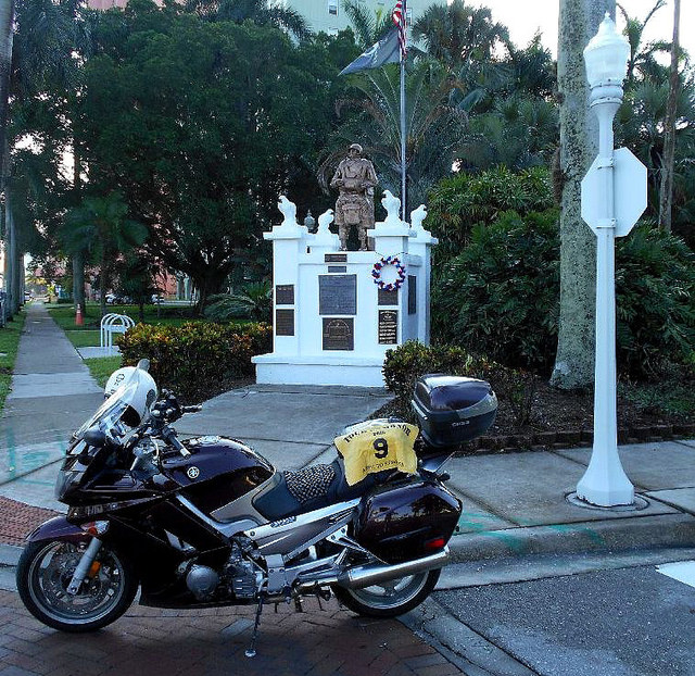 FL6 - 82nd Airborne Monument  Fort Myers, Florida Park of Palms Edwards Dr. and Lee St. GPS: 26.646779, -81.868869 Access: 24/7, unrestricted Parking is available along the street next to the memorial, with no ADA issues. There are also ADA parking spaces across the street at the marina.  Take a photo similar to the one above, along with rider flag and motorcycle. Refer to RULES 5-7 ( http://www.tourofhonor.com/pages/rules.html#rules57 ) for photo verification. Scorers have final say whether standards are met. More....  The 82nd Airborne Division is an active duty airborne infantry division of the United States Army. It specializes in parachute assault operations into denied areas. Based at Fort Bragg, North Carolina, the 82nd Airborne Division is the primary fighting arm of the XVIII Airborne Corps.  The monument is dedicated to all paratroopers and glidermen, living and deceased, who have served during peace or war in the Armed Forces of the United States. Naples (FL) sculptor Andrew McGowan cast and donated the bronze statue of the paratrooper, with the formal dedication made in 1983.  Made in America: Before your visit to Park of Palms, pick up something to go at Gwendolyn's Café, 2400 1st St #101, 2 blocks to the east. Try the Cuban Sandwich, made famous in the area.