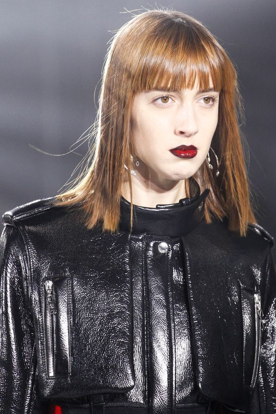 Glossy red pout with a darker lipliner at Louis Vuitton