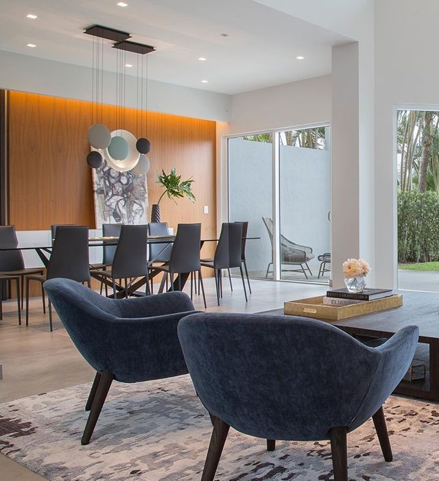 Cozy, elegant and just the right amount of blue in this beautiful dinning living area,  @phlphotography  #agsiadesigngroup #moderninterior #modernhouses #instadecor #decoracÃo #architecturephotography #miamiinteriors #aventuradesigners #sunnyisles #goldenbeach #vibia #cattelan #custocarpentry #poliform #restorationhardware #animadomus #addisonhouse #westelm