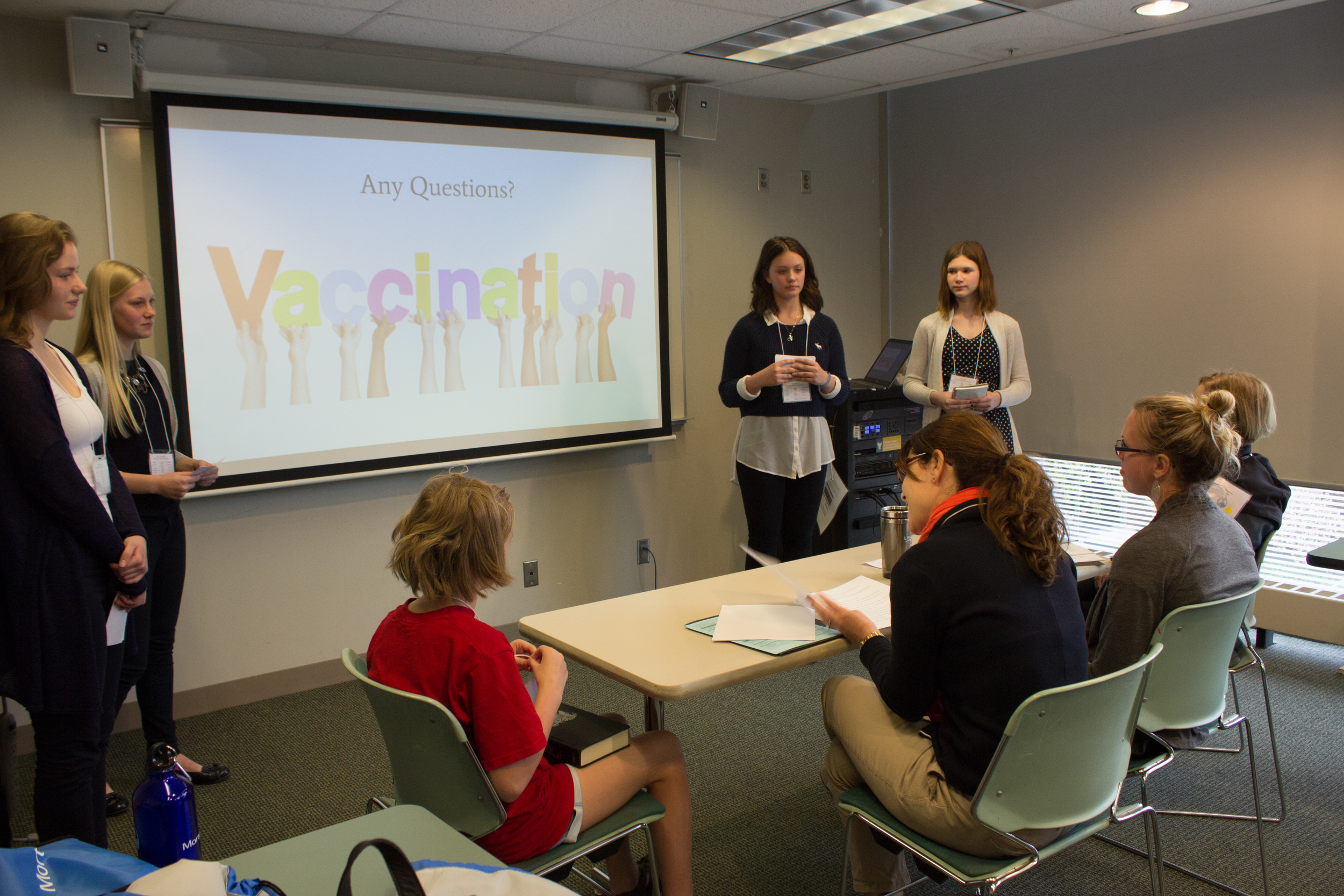vaccination presentation with judges table.jpg