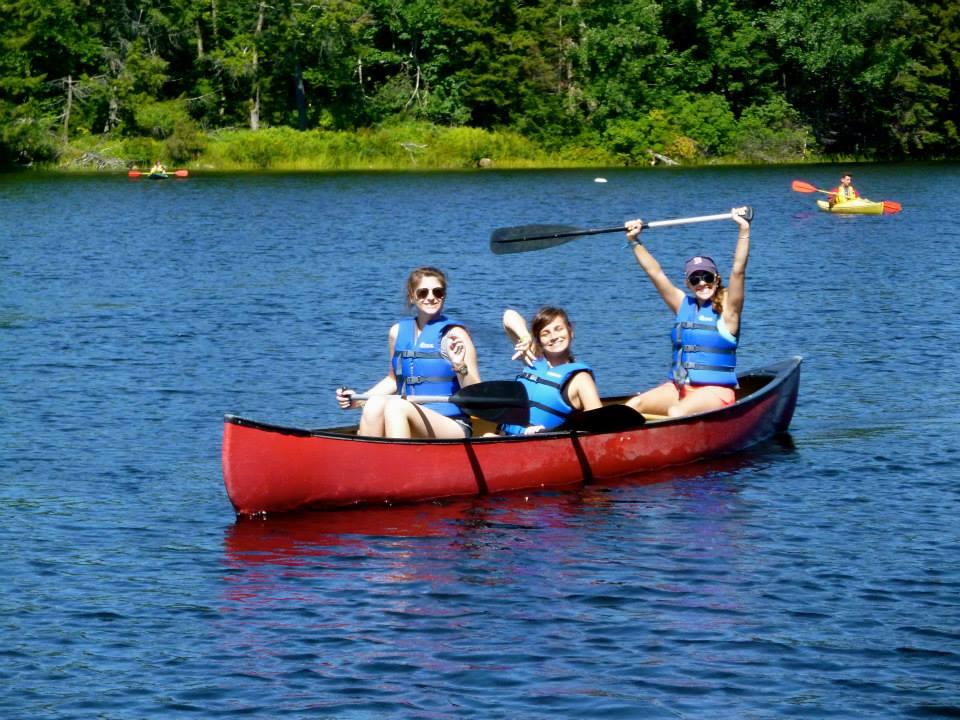 """Coral (left) canoeing with camper Ellen and volunteer Lara """"Aqua"""" Gechijian"""