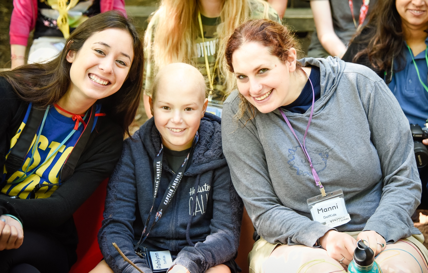 Hull (center), surrounded by camp volunteers Alexandra Mullaney (left) and Samantha Schilit (right). Photo provided by Christian Pleva Images.
