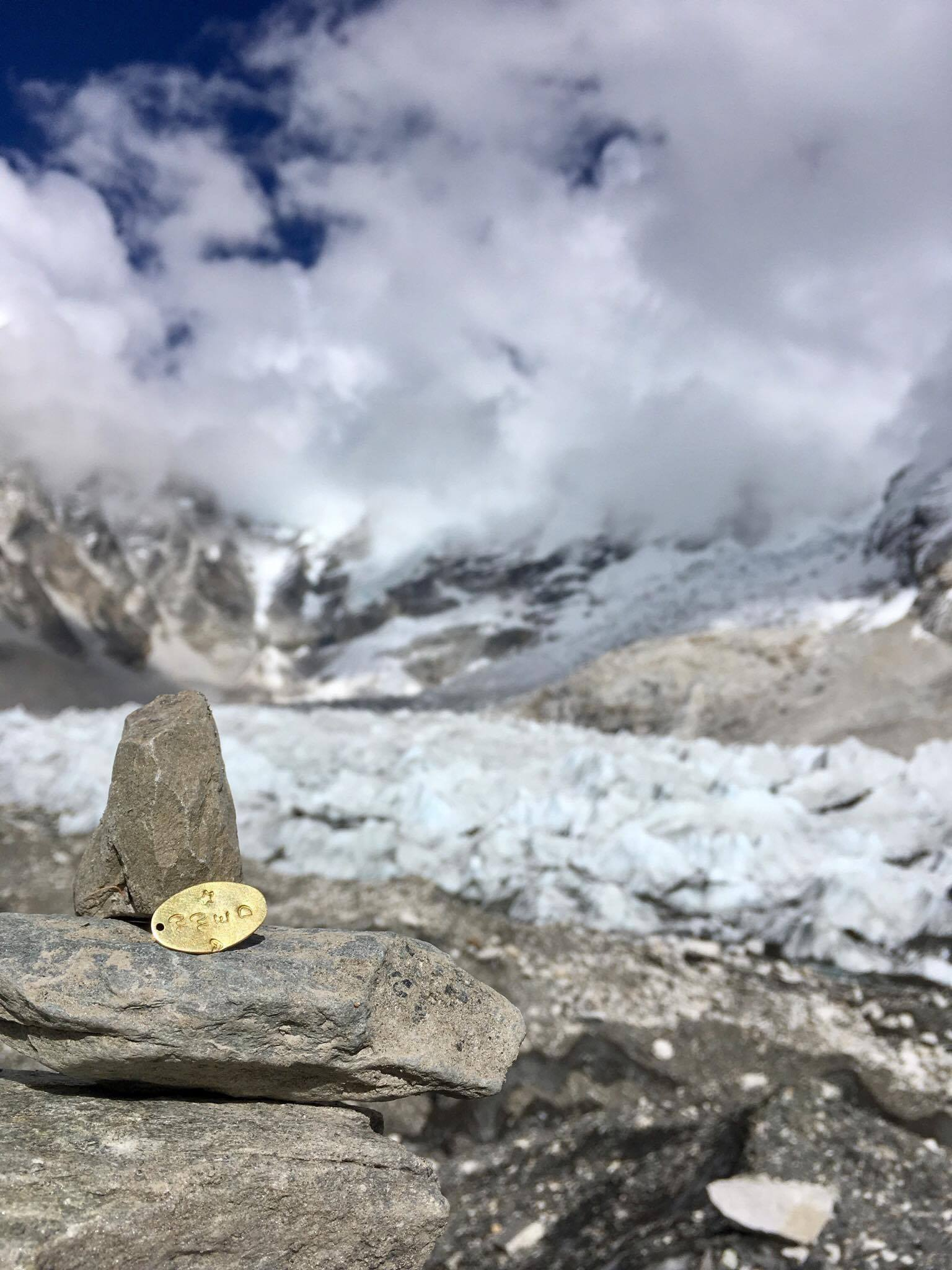 Ellen's charm atop Mt. Everest. Photo Credit: Jakob Muhic