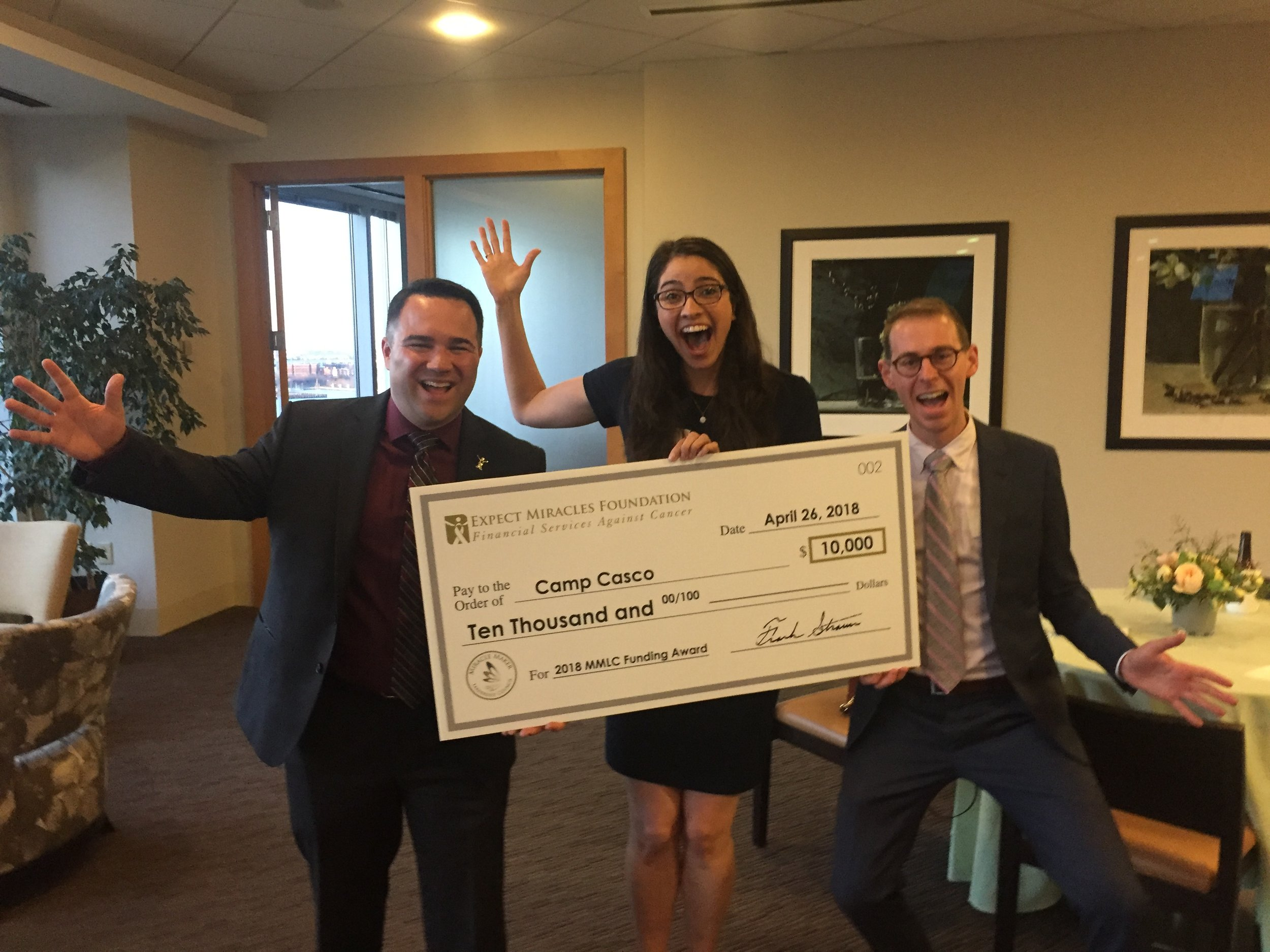"Brian Rudenauer (MMLC member), Whitney ""Karat"" Silkworth (CC Grants Director), and Nathan ""Radio"" Schauer (CC Day Camp Activities Manager) accept the MMLC check on our behalf!"