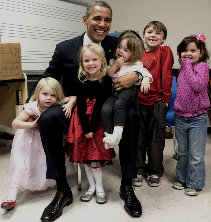 Two days after the Sandy Hook Elementary School shooting at Newtown, Connecticut on 14 December 2012, United States President Barack Obama travelled to Connecticut to meet with the victims' families and to speak at a prayer vigil. The President spent hours greeting family members. Difficult as that was for everyone, the one moment that helped sooth the pain was when he posed for a photograph with the siblings and cousins of Emilie Parker, one of the twenty children who died in the shooting..•  Wikimedia