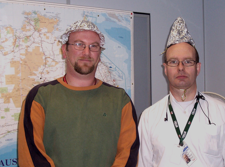 Two people wearing protective Tin Foil Hats .Photo by Jodie McGrath •  Wikimedia