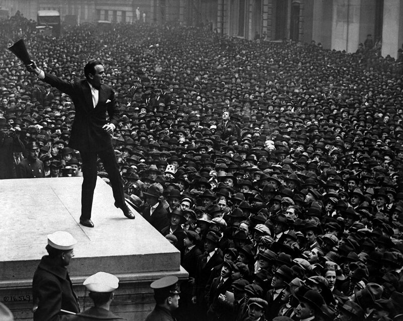 Douglas Fairbanks, movie star, speaking in front of the Sub-Treasury building, New York City, to aid the third Liberty Loan. •  Wikimedia Commons