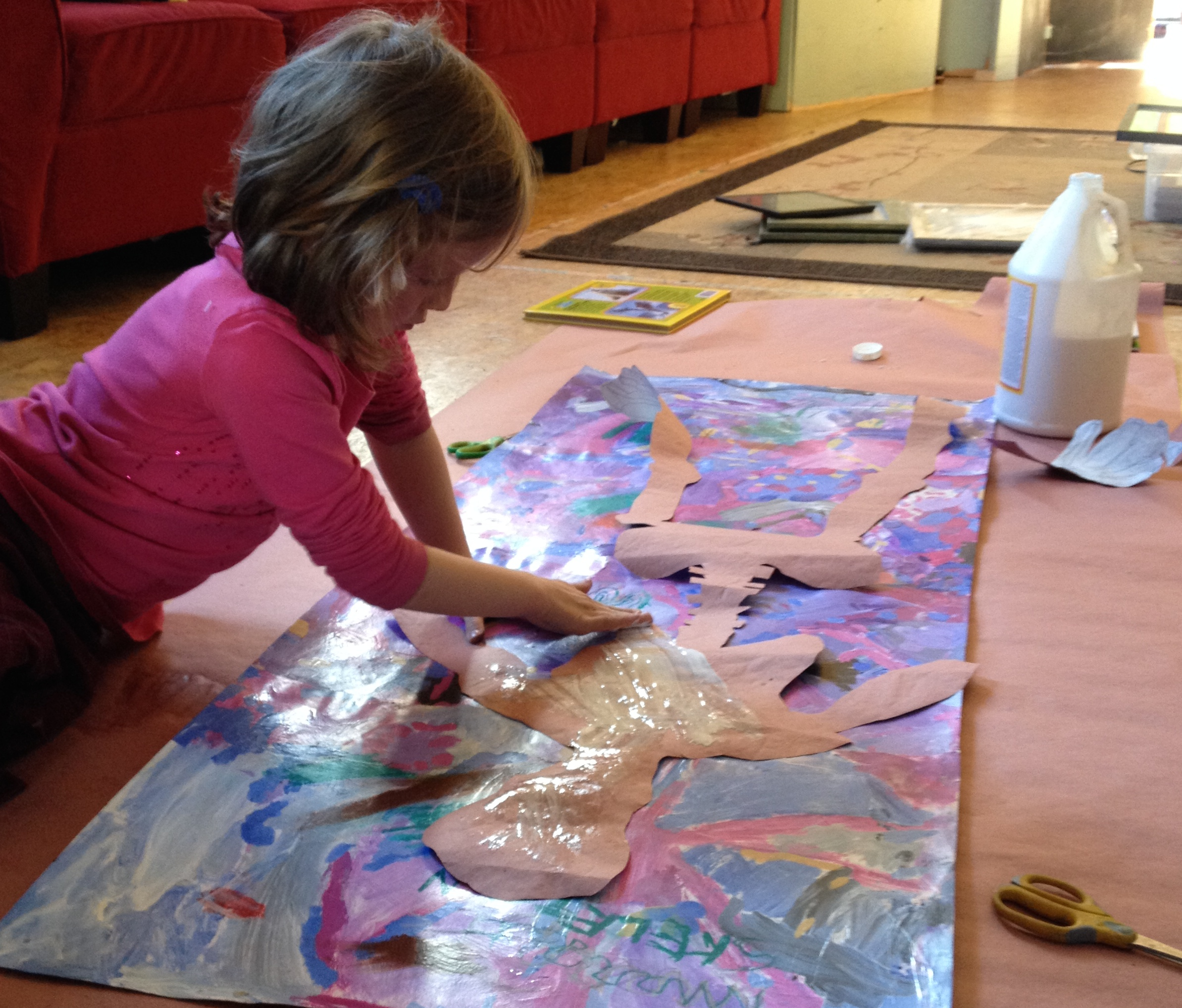 large-scale collage on the floor, age 6