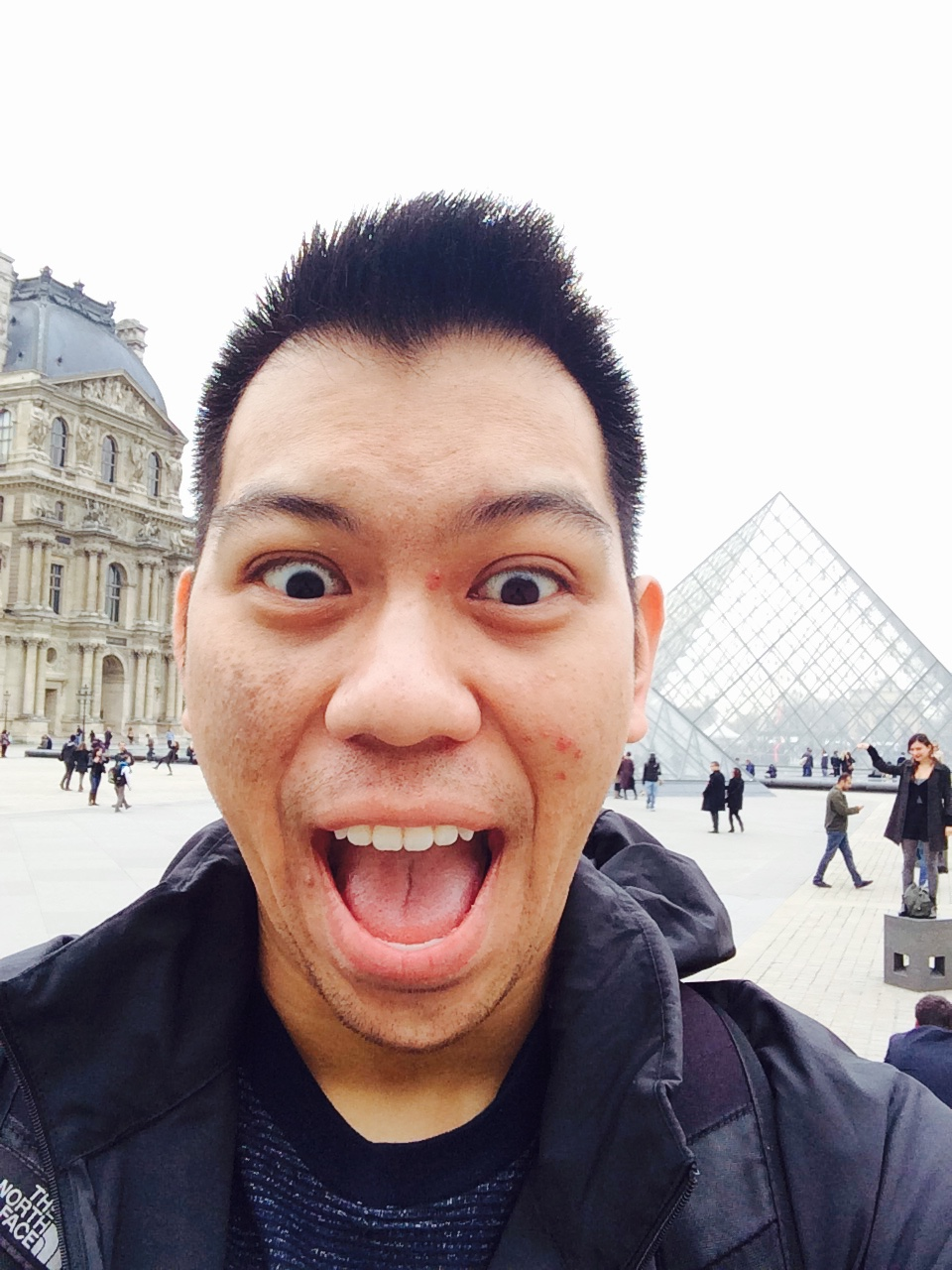 Snapping a silly shot in front of the Louvre