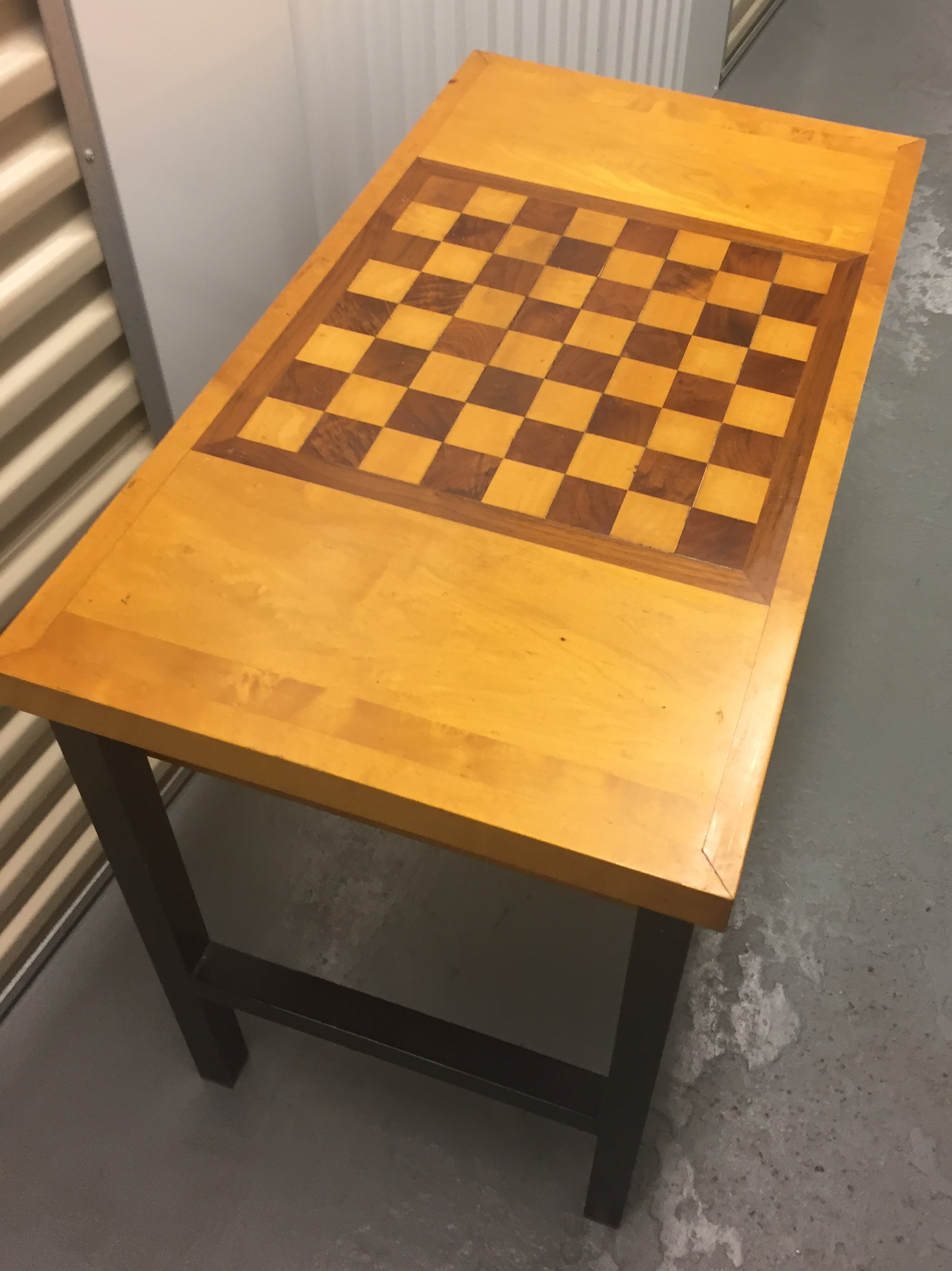 Inlaid squares, metal legs, drawers for pieces. Other than a tiny cigarette burn (the spot to the left of the corner at the top of the board), the table is in great shape!