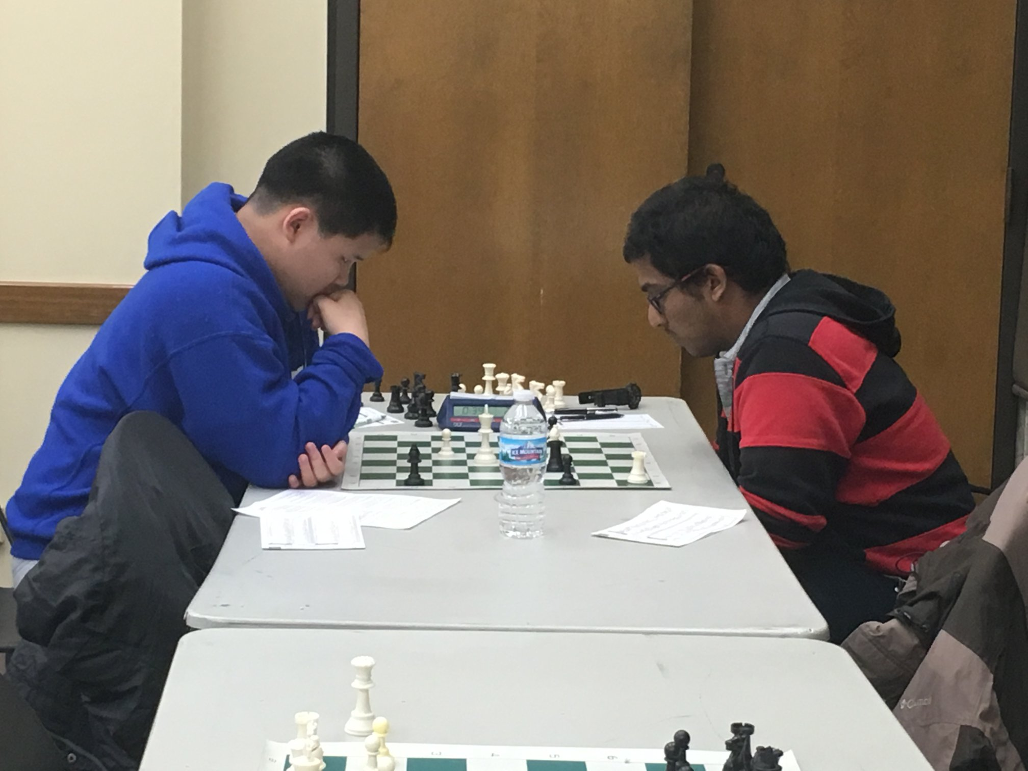 14-year-old GM Awonder Liang (left) defeated GM Priyadharshan Kannappan in the final round.  (Photo: Hiro Higuchi)