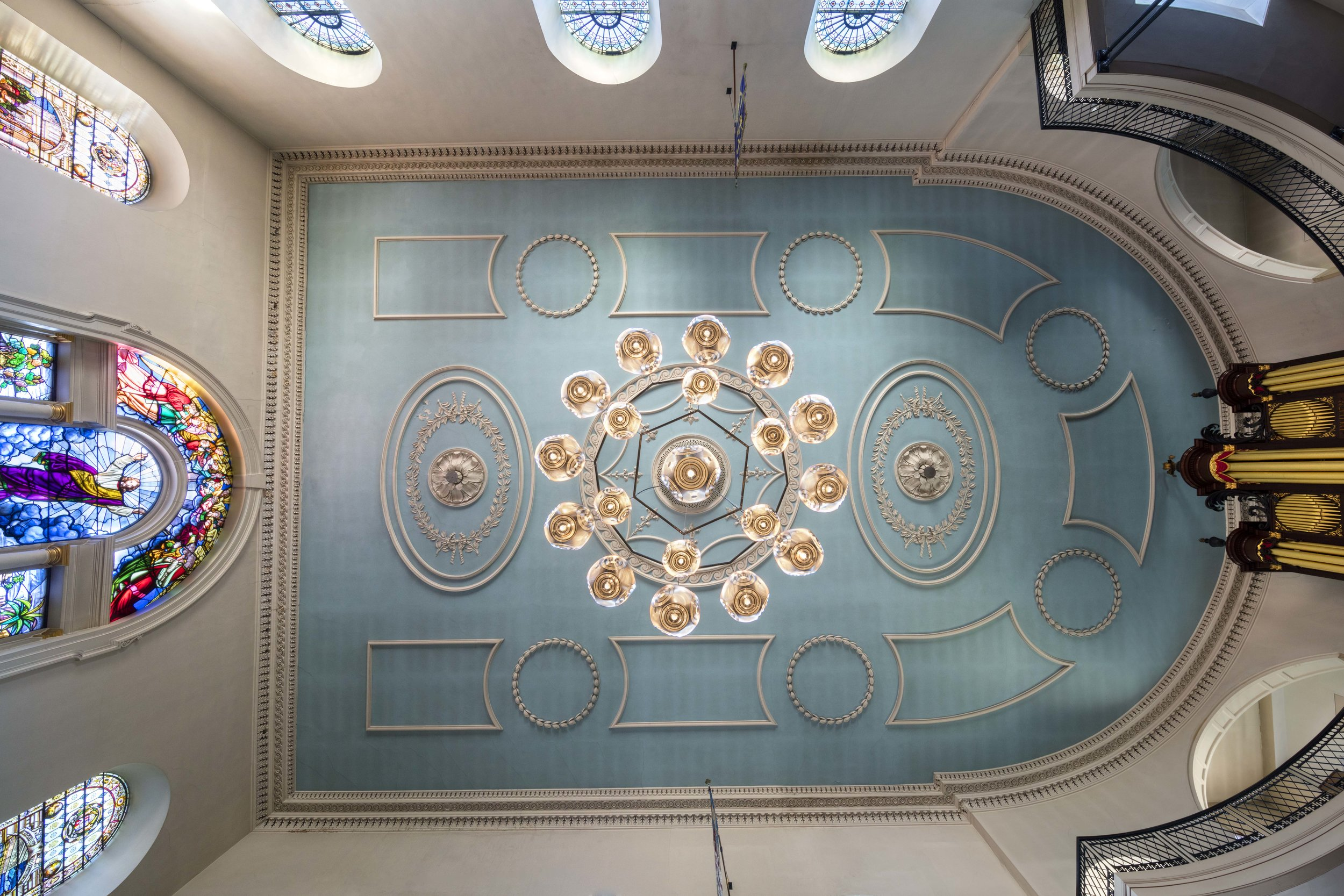 Chandelier of Curve Ball Pendants for Milan design week. Now installed at St. James Church, London