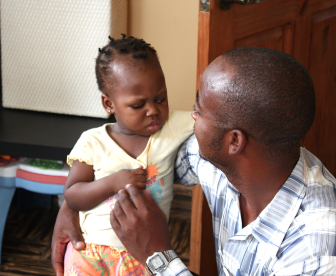 Alix, our orphanage director, comforts Ysmerline.