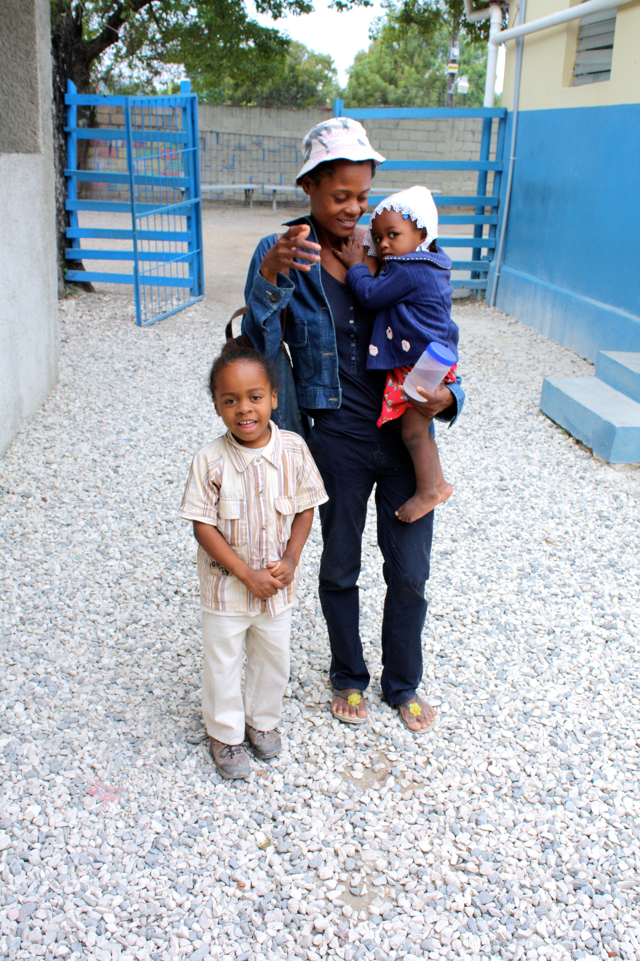 Emmanuel with mom and baby sister