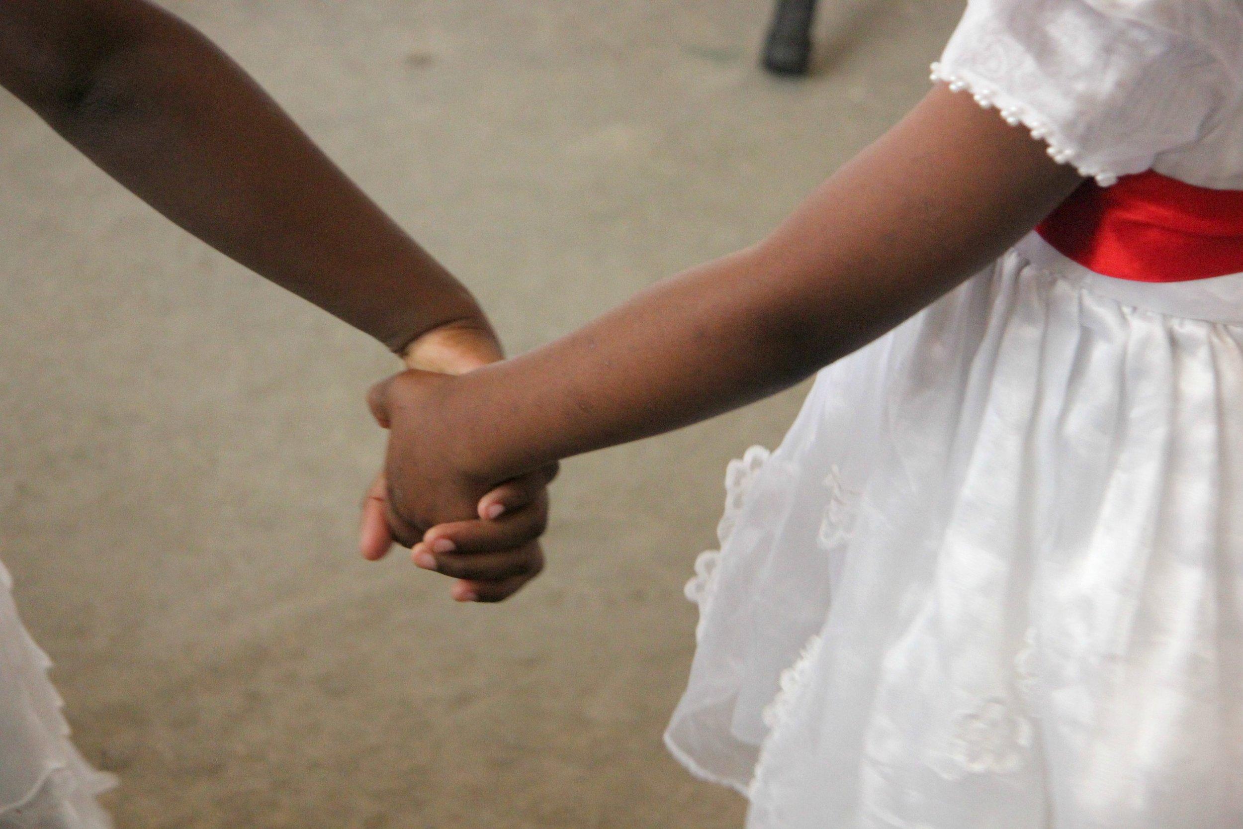 EDIT girls holding hands.jpg