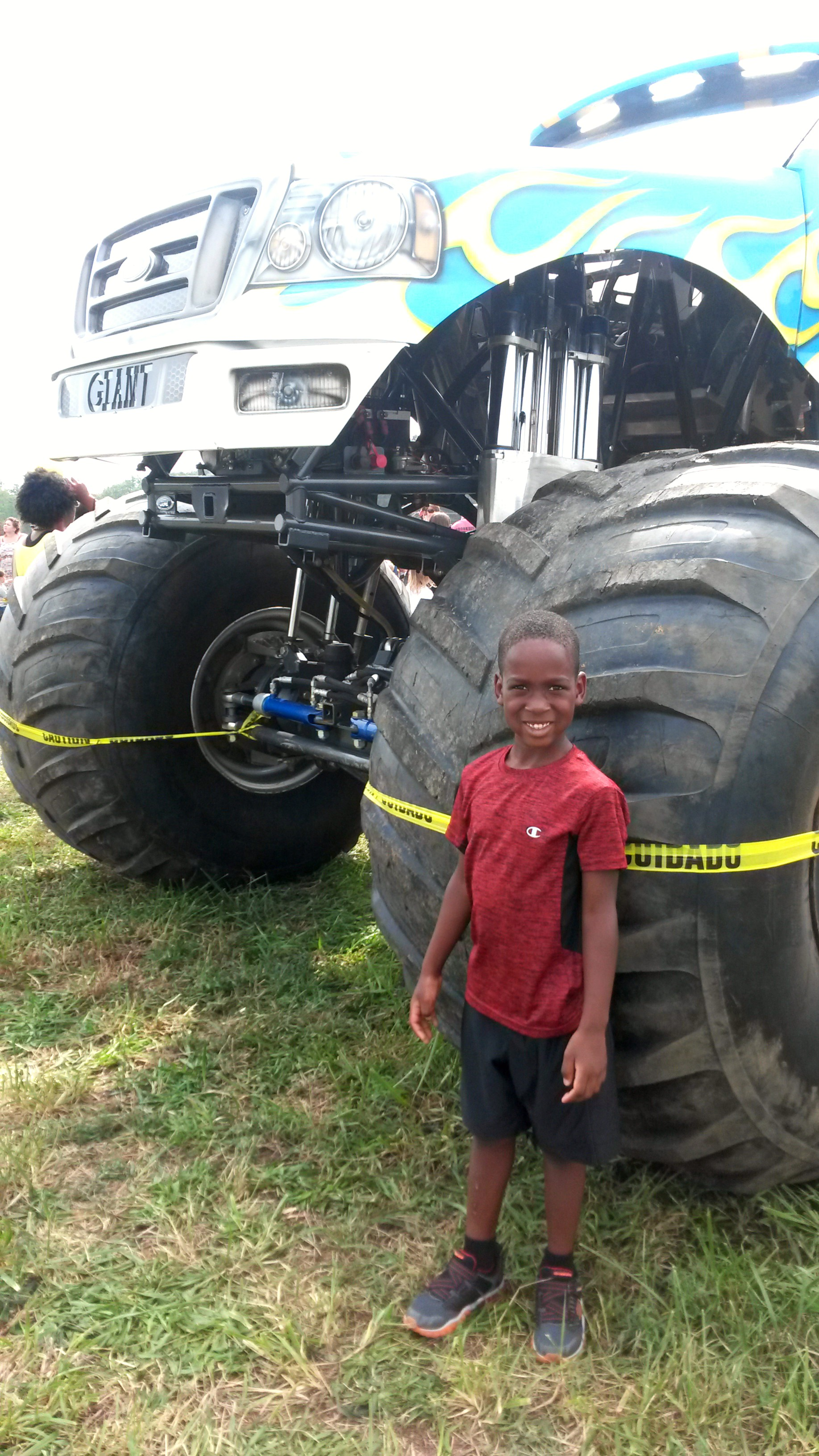 """At a """"Touch a Truck"""" event— Tre LOVES monster trucks!"""