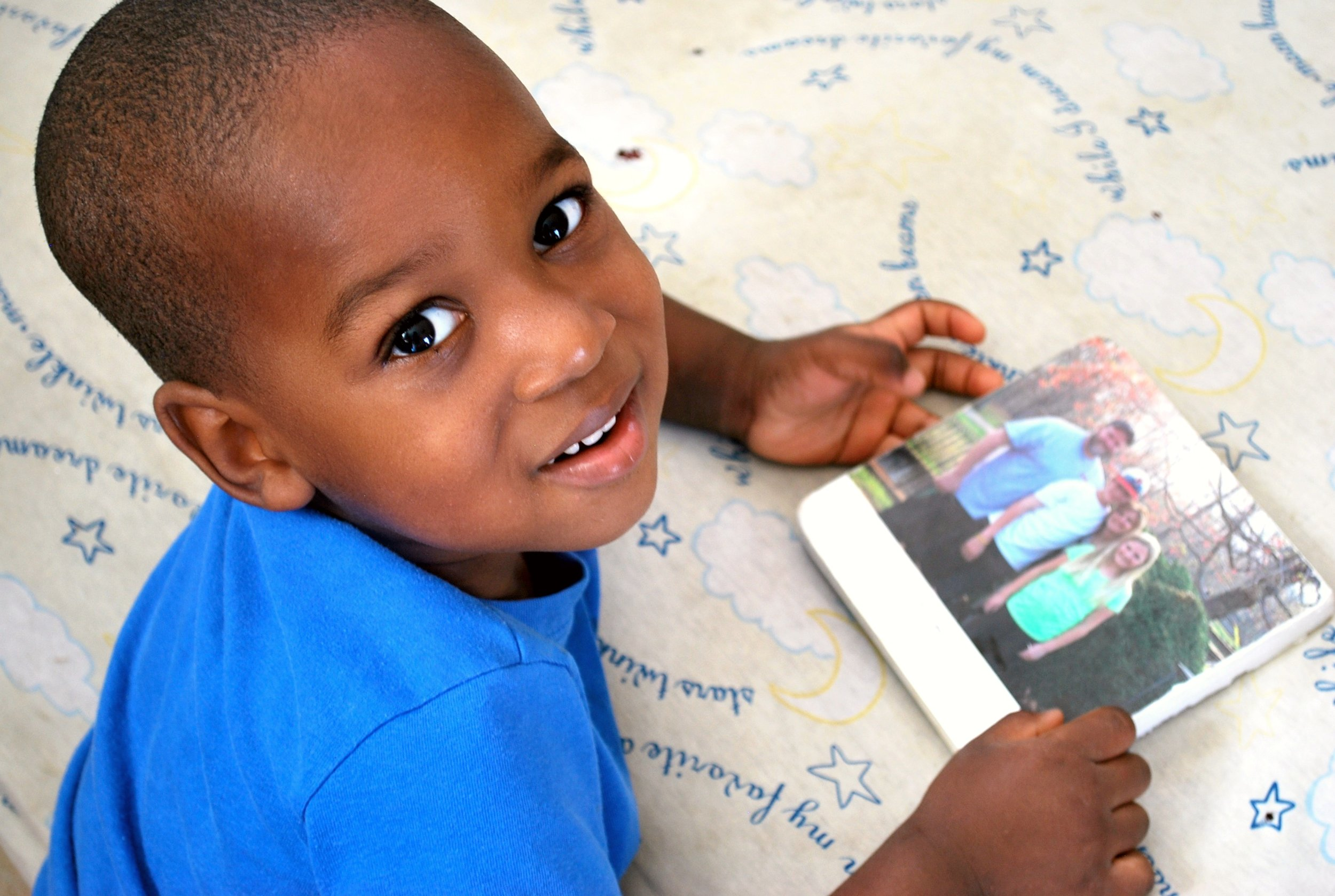 Tre loved to look at photos of his family before he went home with them