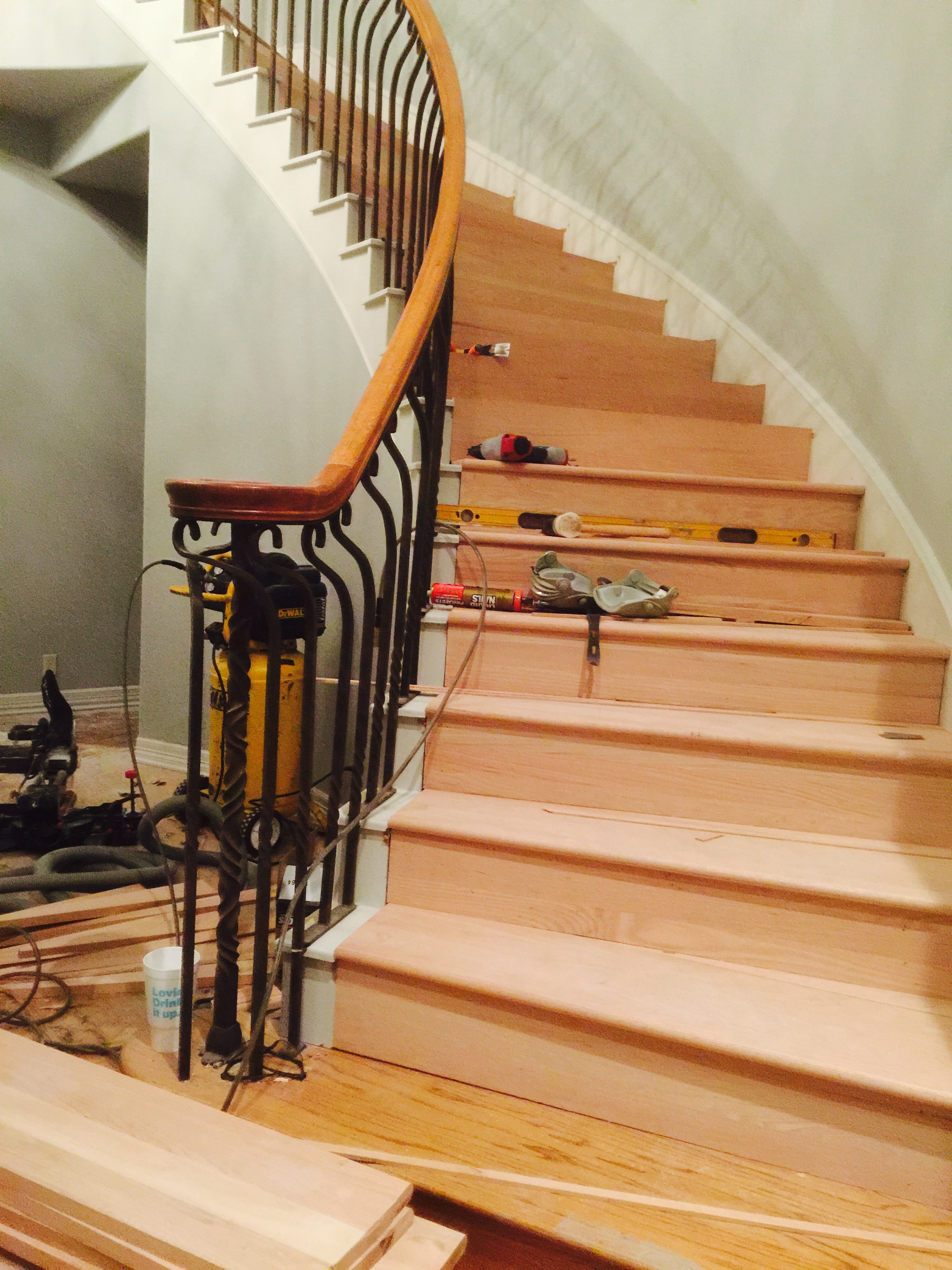 Removed carpet and installed curved solid oak stair treds.