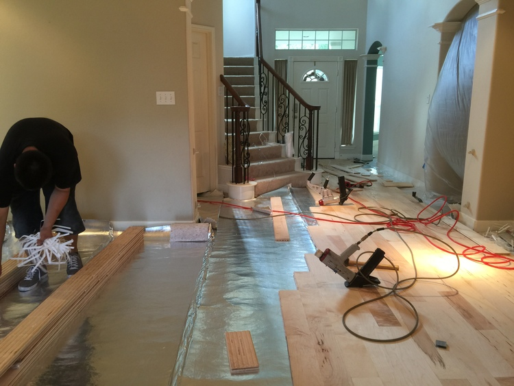 Installed solid maple wood flooring nailed down 5 inch.