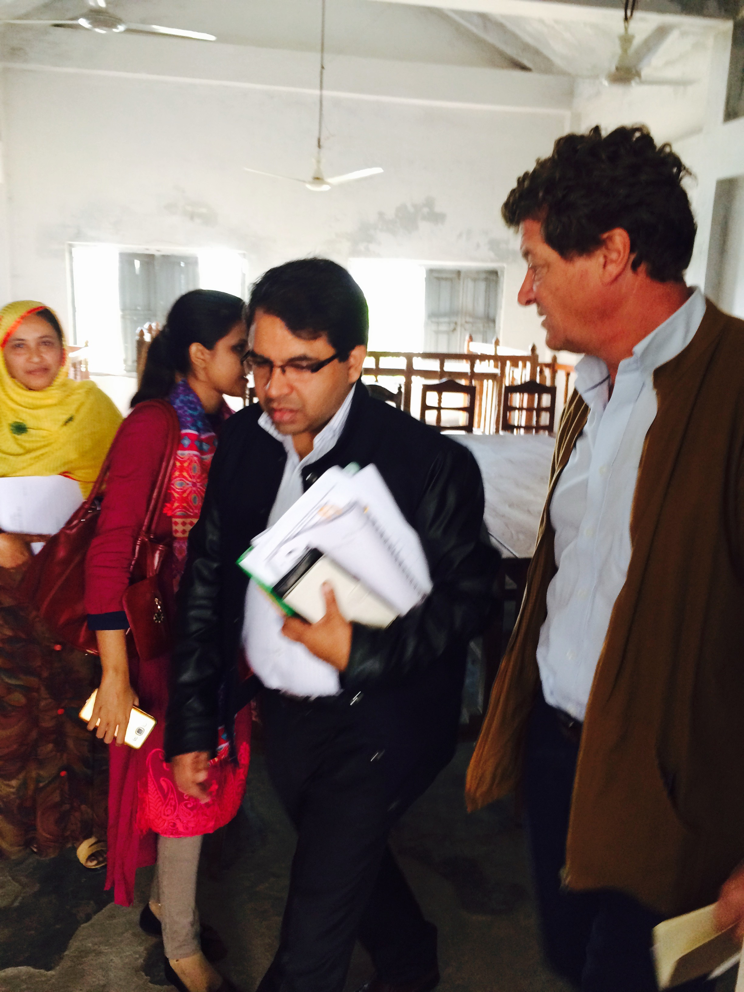 Adam Stapleton and Morshed Alam visiting a Village Court in Madaripur District