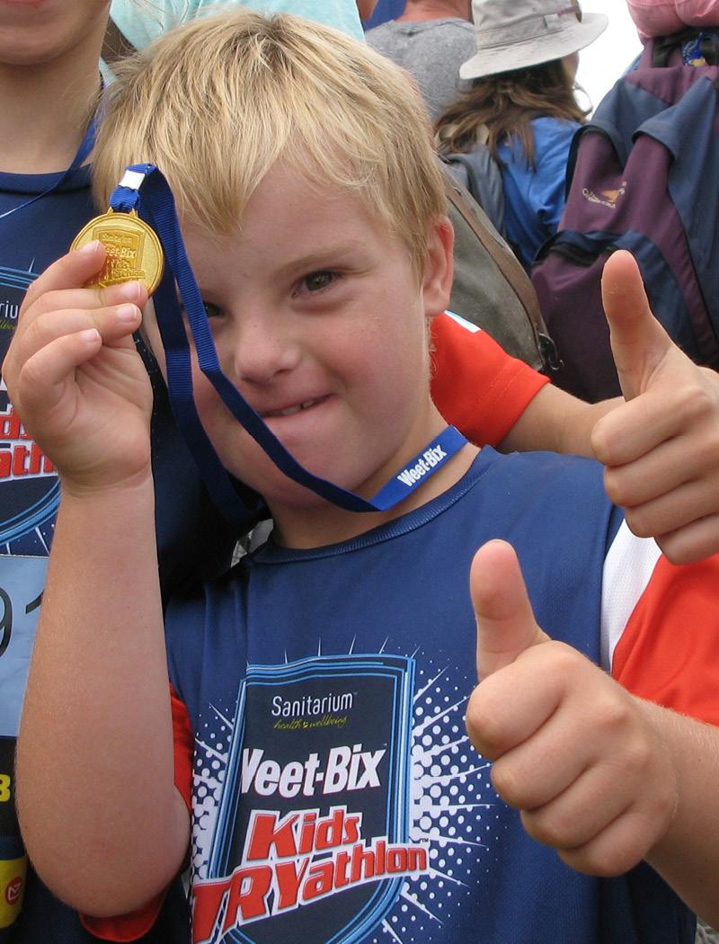 Nikolai with his Weet-Bix triathlon medal.
